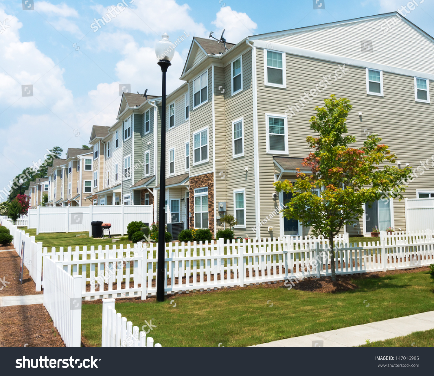 Suburban three story town homes stock photo 147016985 for 3 story townhomes