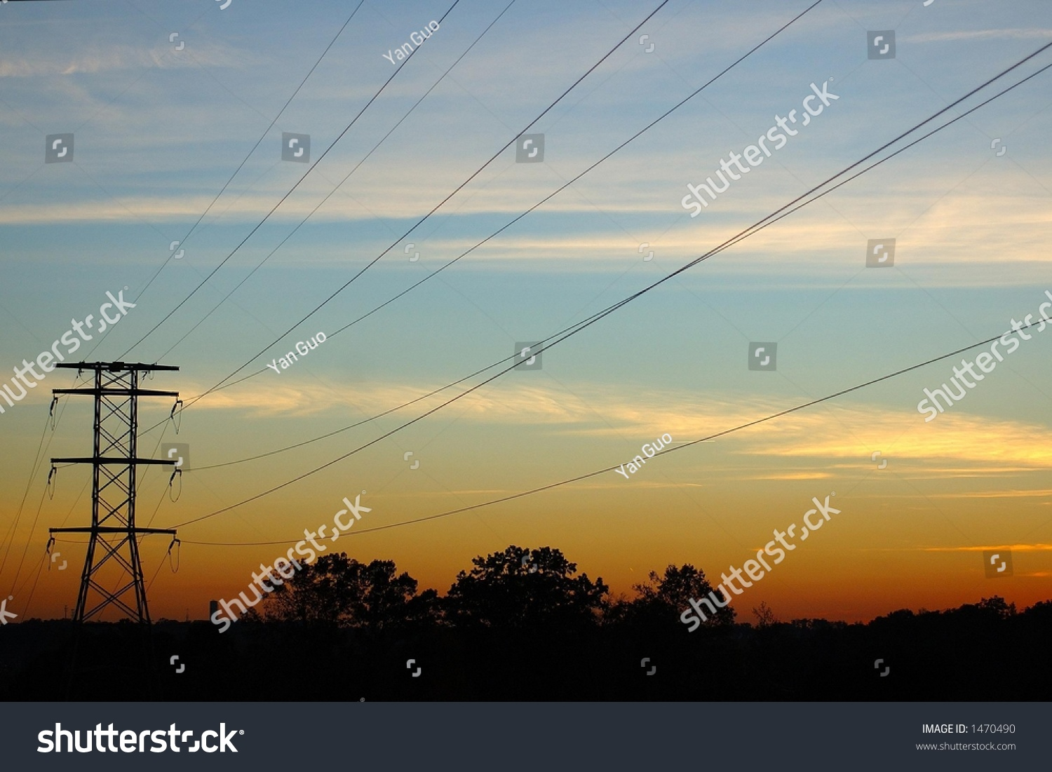 High-Voltage Electronic Power Lines In Sunset Stock Photo ...