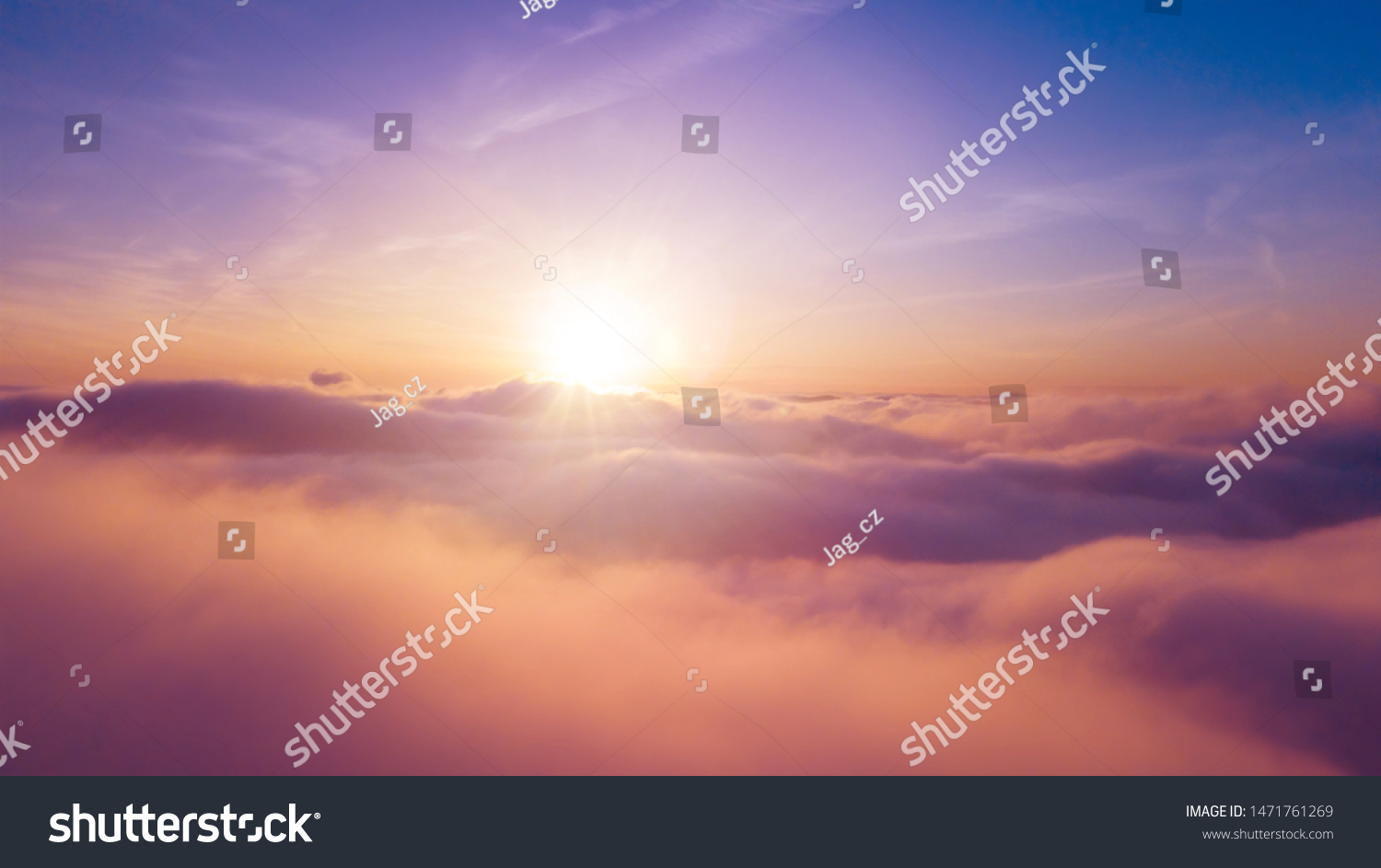 Beautiful sunset cloudy sky from aerial view. Airplane view above clouds #1471761269