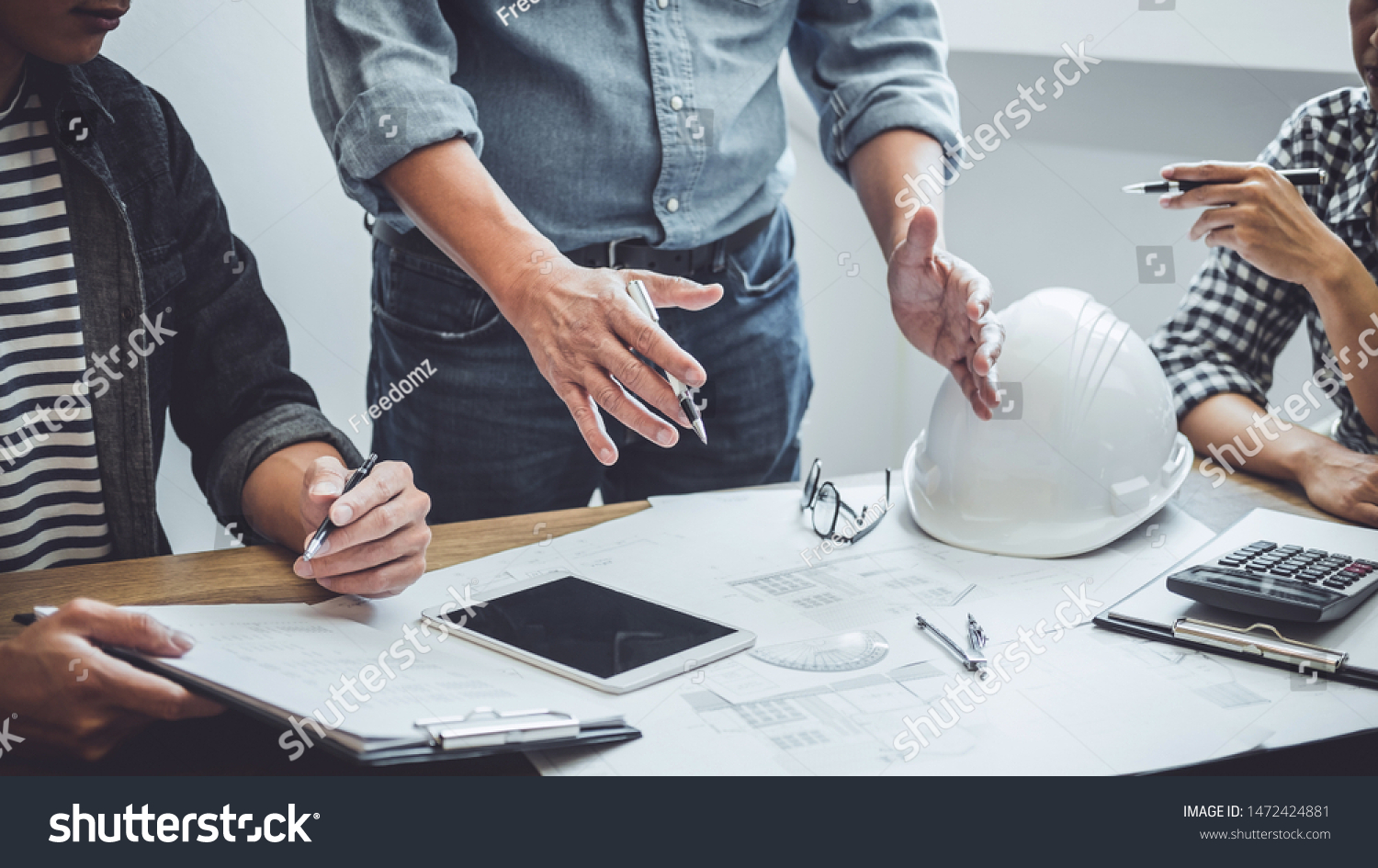 Construction and structure concept of Engineer or architect meeting for project working with partner and engineering tools on model building and blueprint in working site, contract for both companies. #1472424881