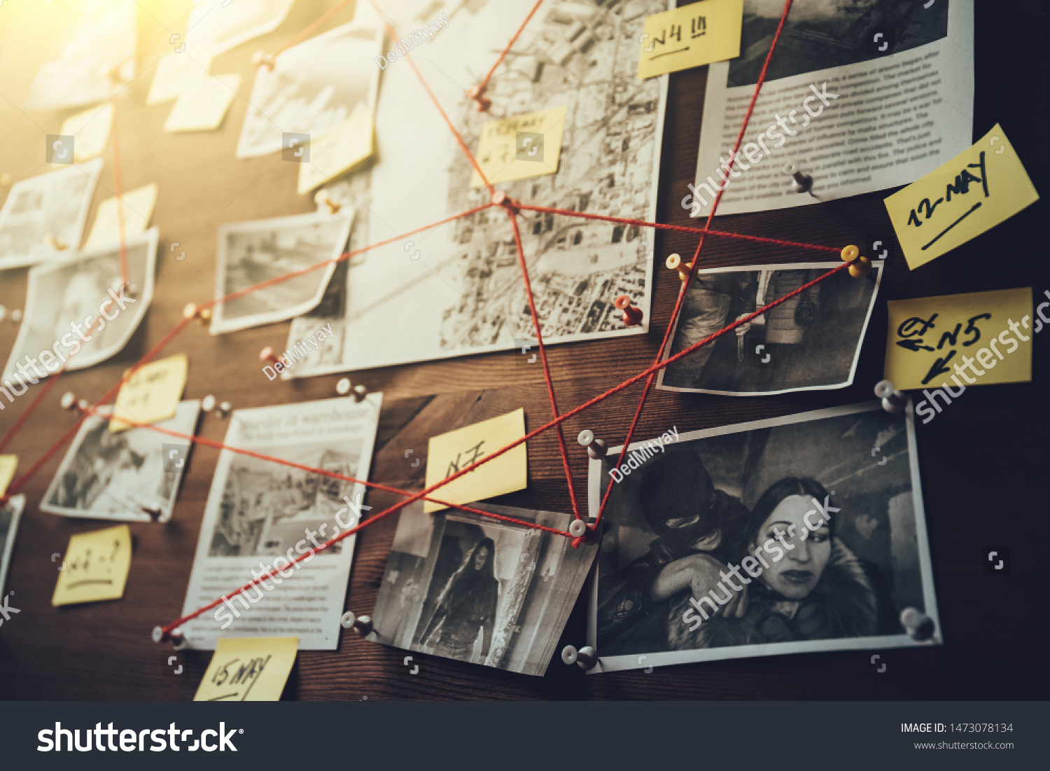 Detective board with photos of suspected criminals, crime scenes and evidence with red threads, selective focus, retro toned #1473078134