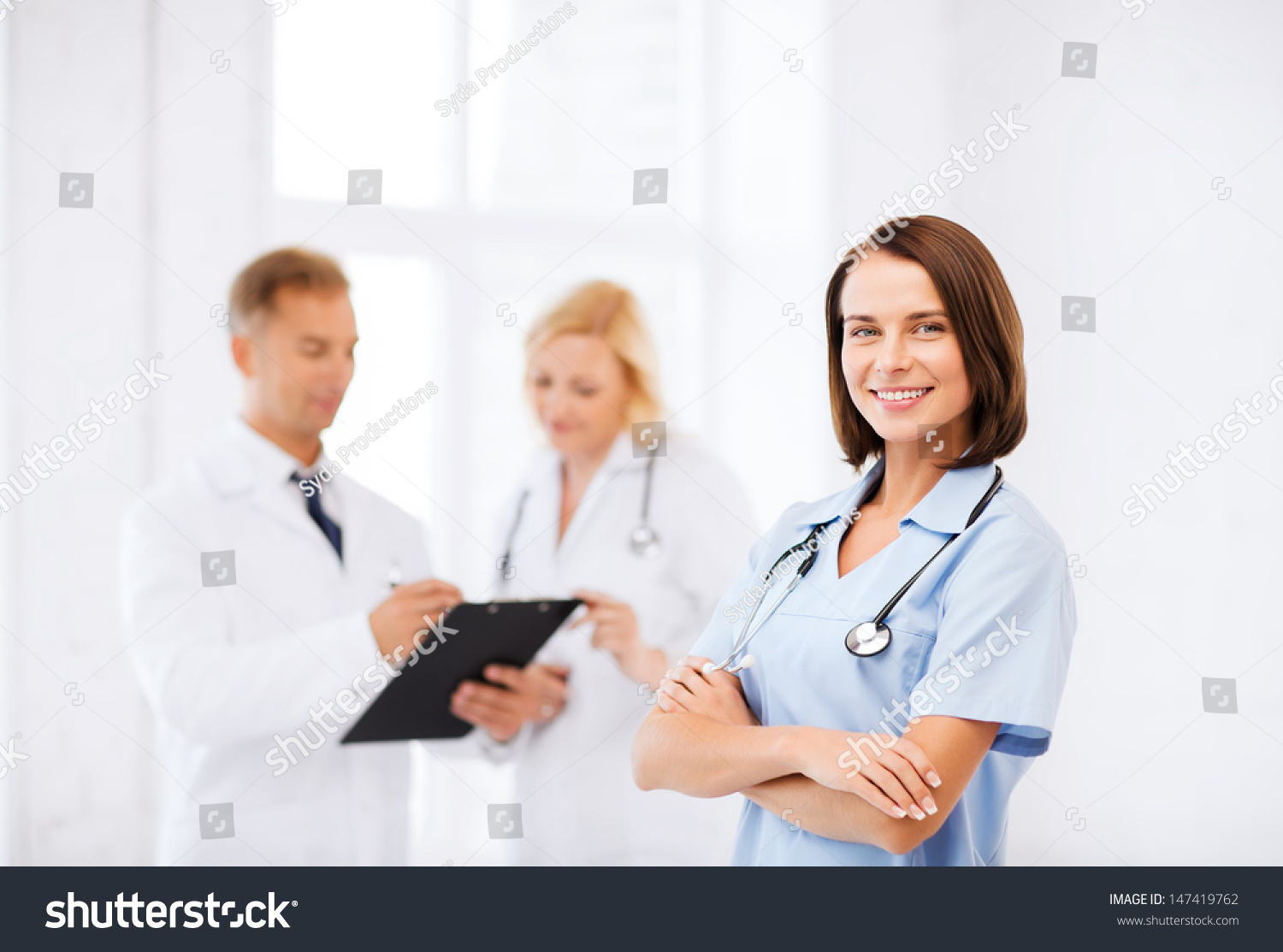 healthcare and medical concept young female doctor with stethoscope