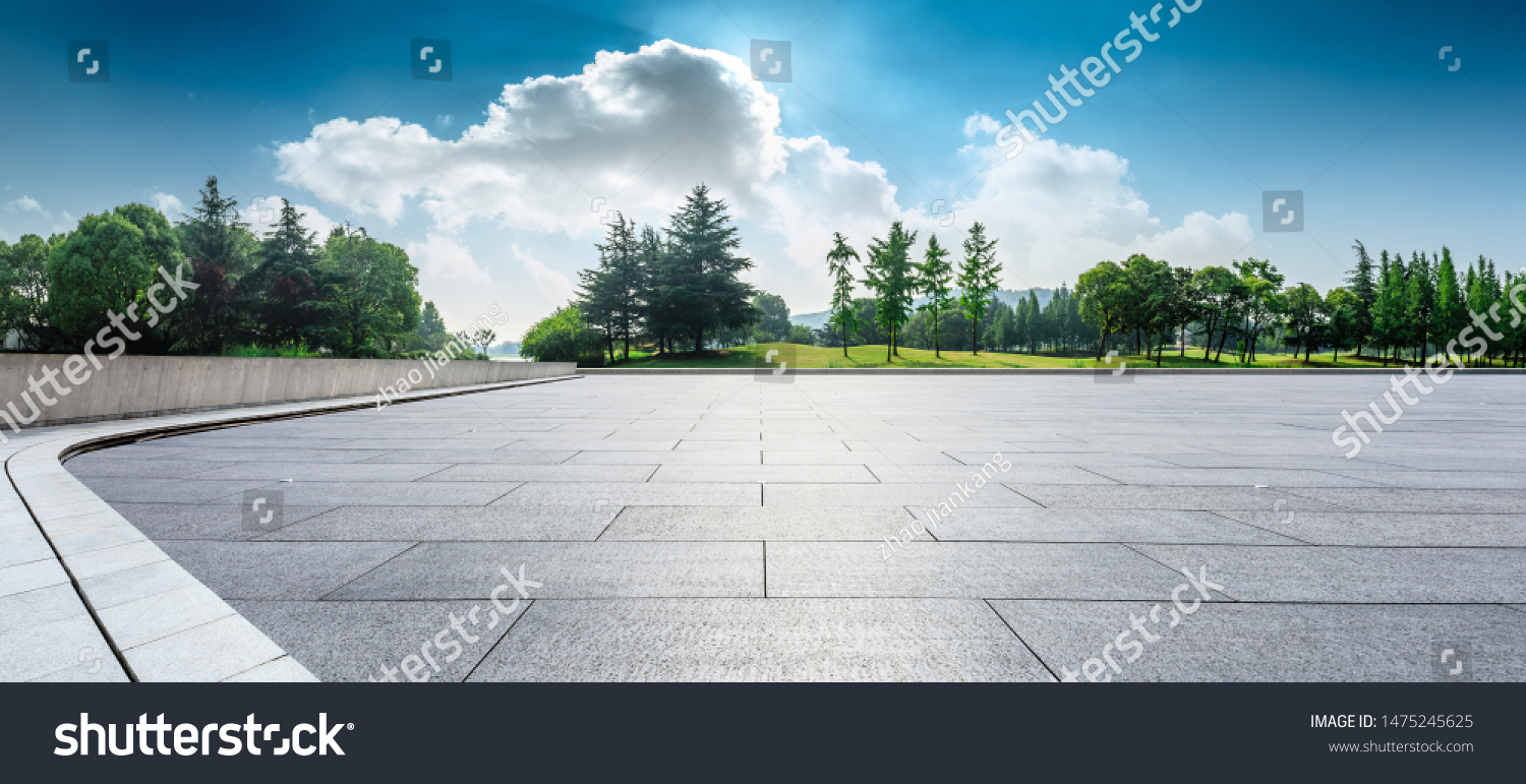 Empty square floor and green woods natural scenery in city park #1475245625