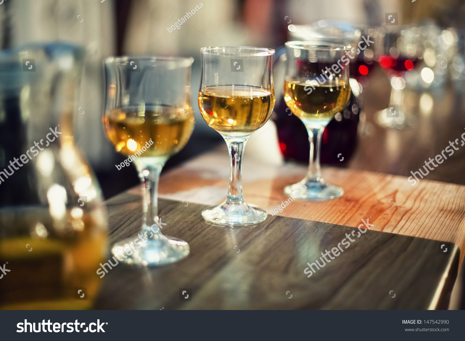 various types of exquisite wine in glasses at dress cocktail party