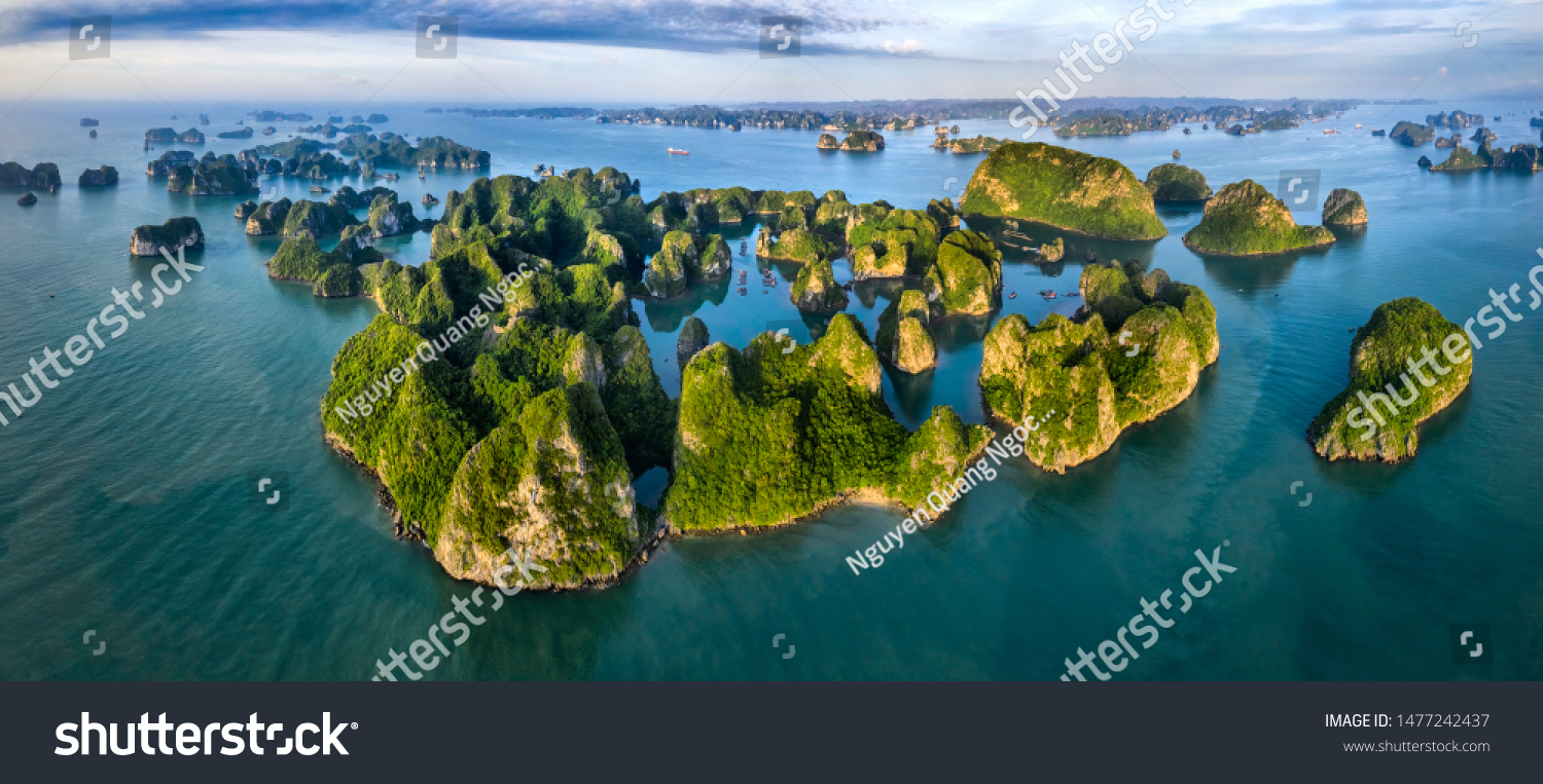 Aerial view Vung Vieng floating fishing village and rock island, Halong Bay, Vietnam, Southeast Asia. UNESCO World Heritage Site. Junk boat cruise to Ha Long Bay. Famous destination of Vietnam #1477242437