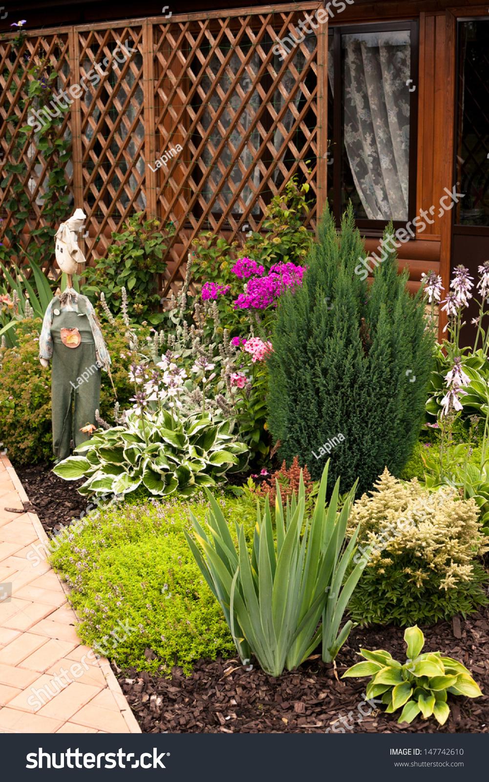 Beautiful garden flowers scare craw stock photo edit now 147742610 beautiful garden with flowers and scare craw izmirmasajfo