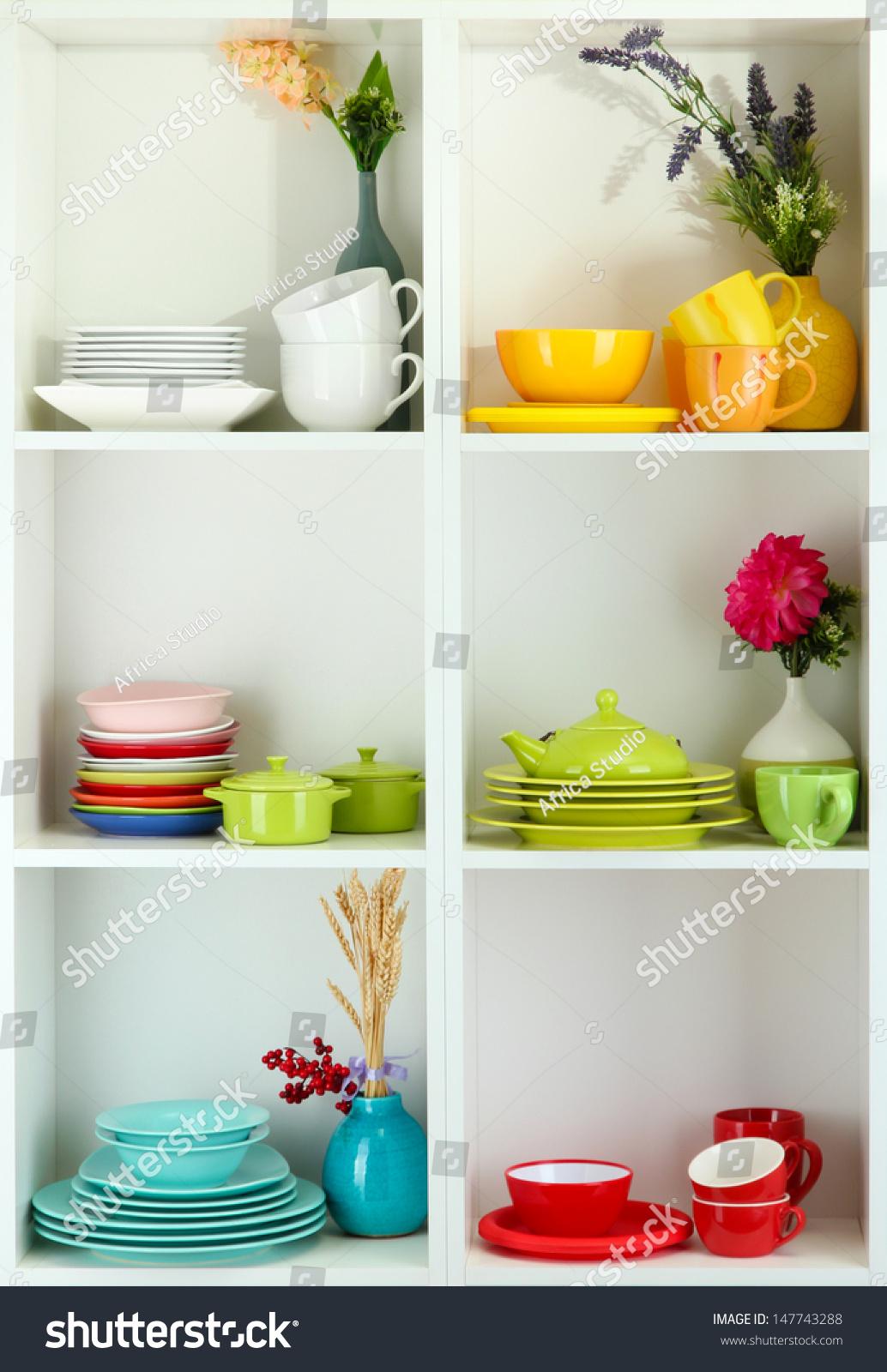 Beautiful white shelves with tableware and decor stock photo 147743288 shutterstock - Beautiful photoshelves ...