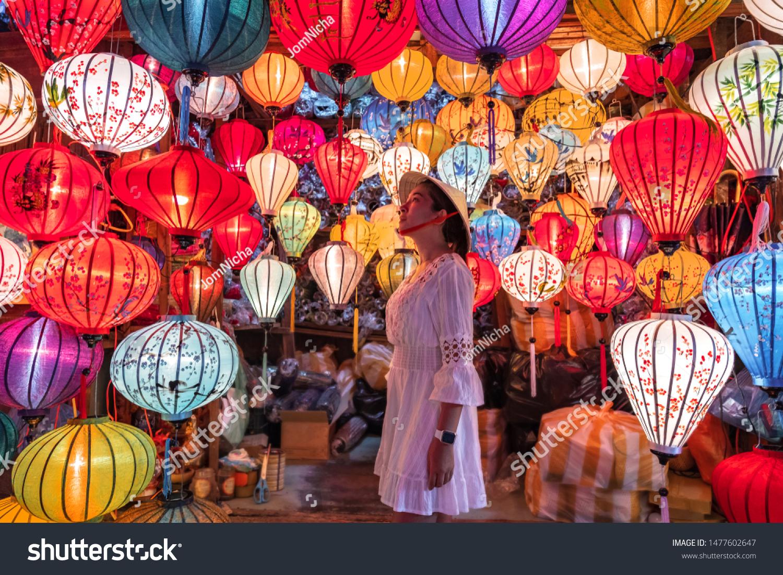 Travel woman choosing lanterns in Hoi An, Vietnam #1477602647