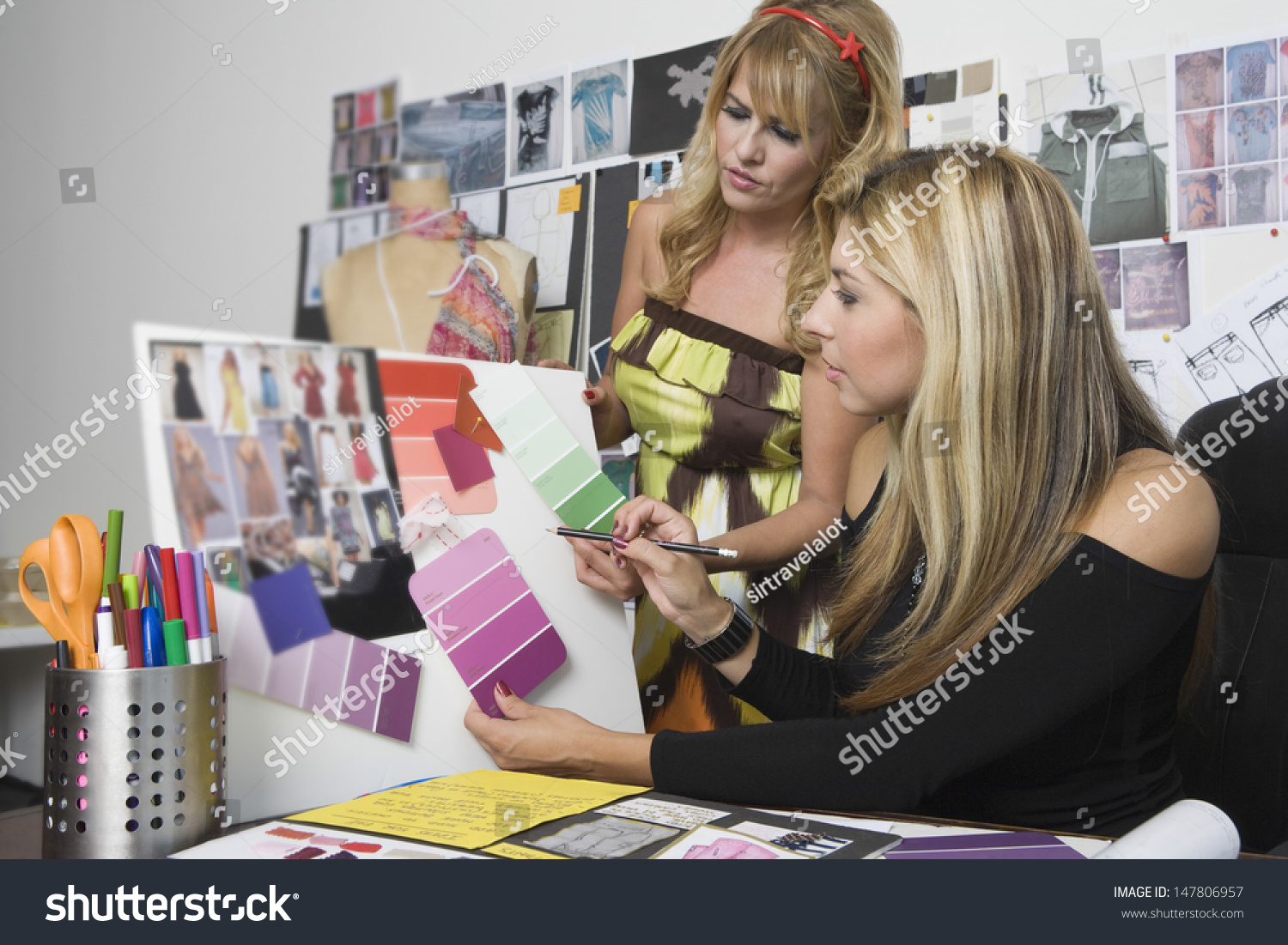Female Fashion Designers Working At Desk Stock Photo ...