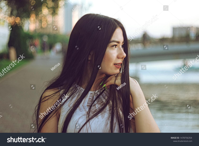 Asian girl looking forward profile view