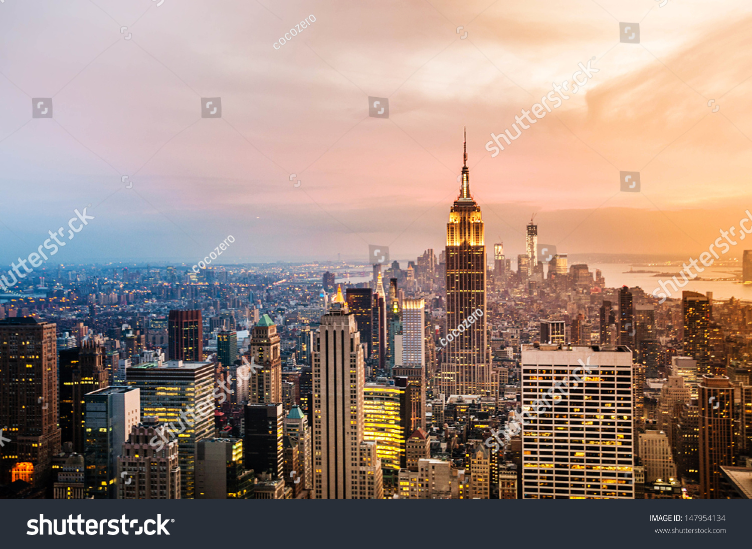 New York City skyline with urban skyscrapers at sunset.  #147954134