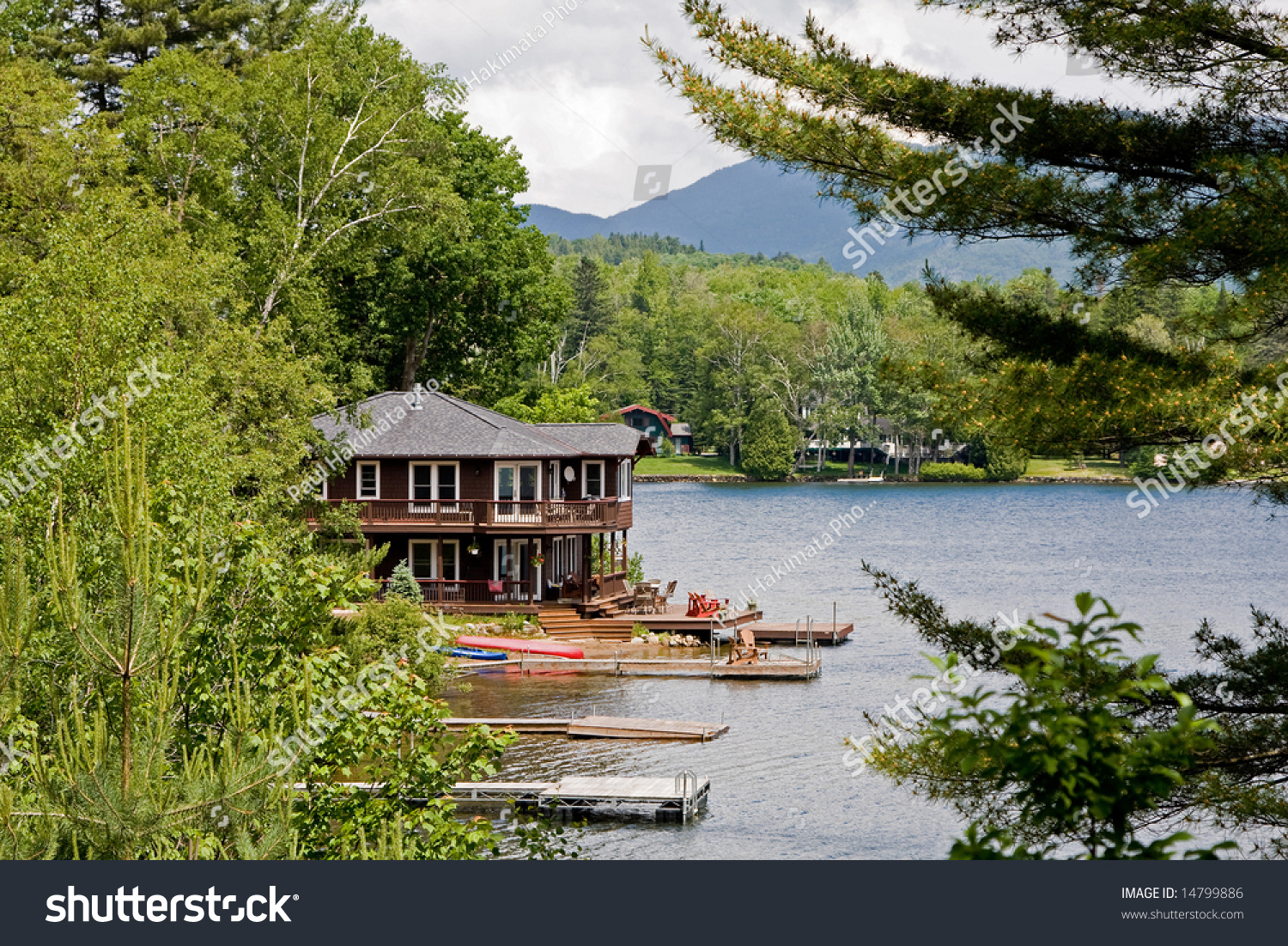 Beautiful House On The Water Side Surrounded By Trees
