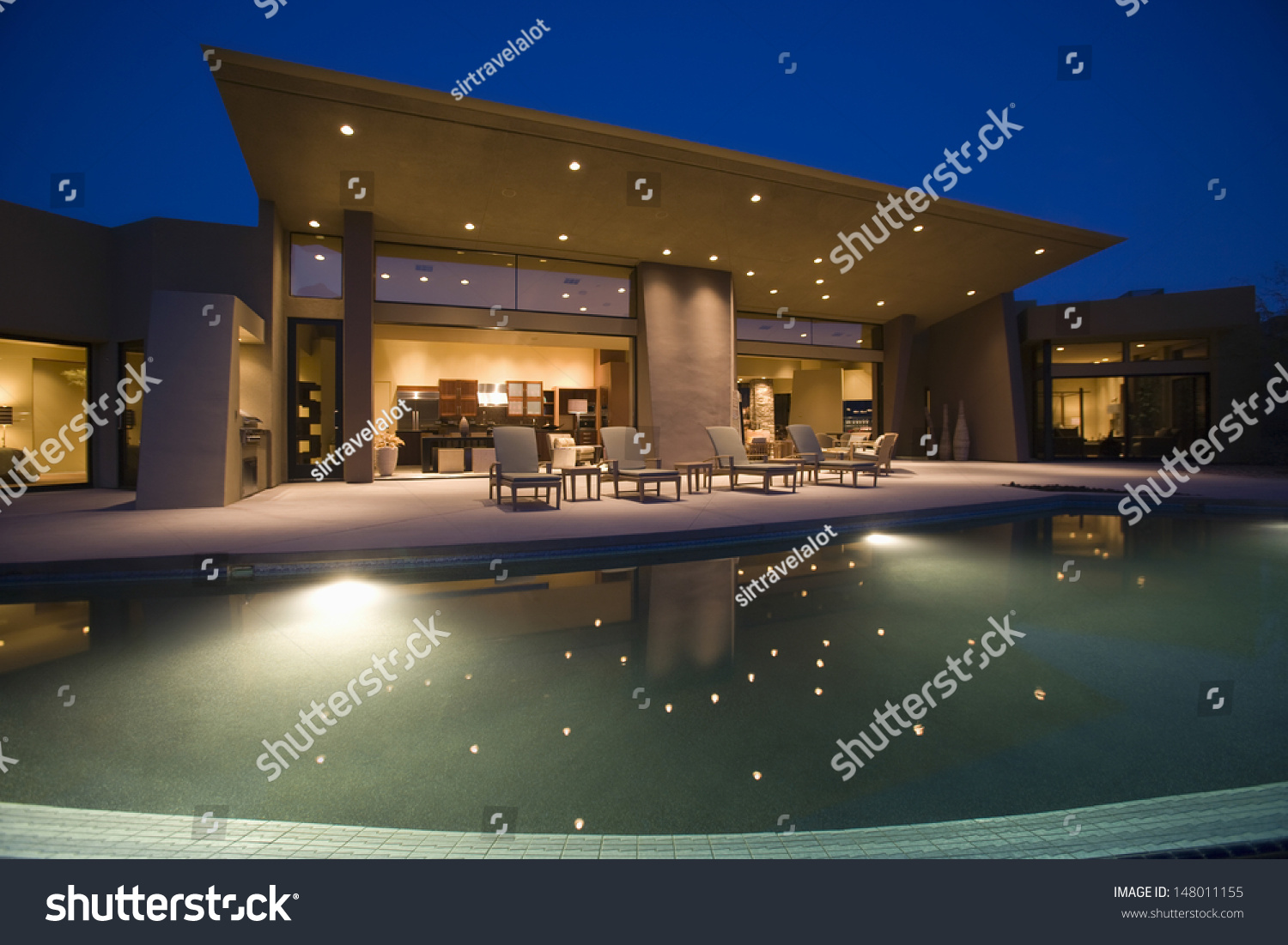 Luxurious And Modern House With Swimming Pool At Night Stock Photo