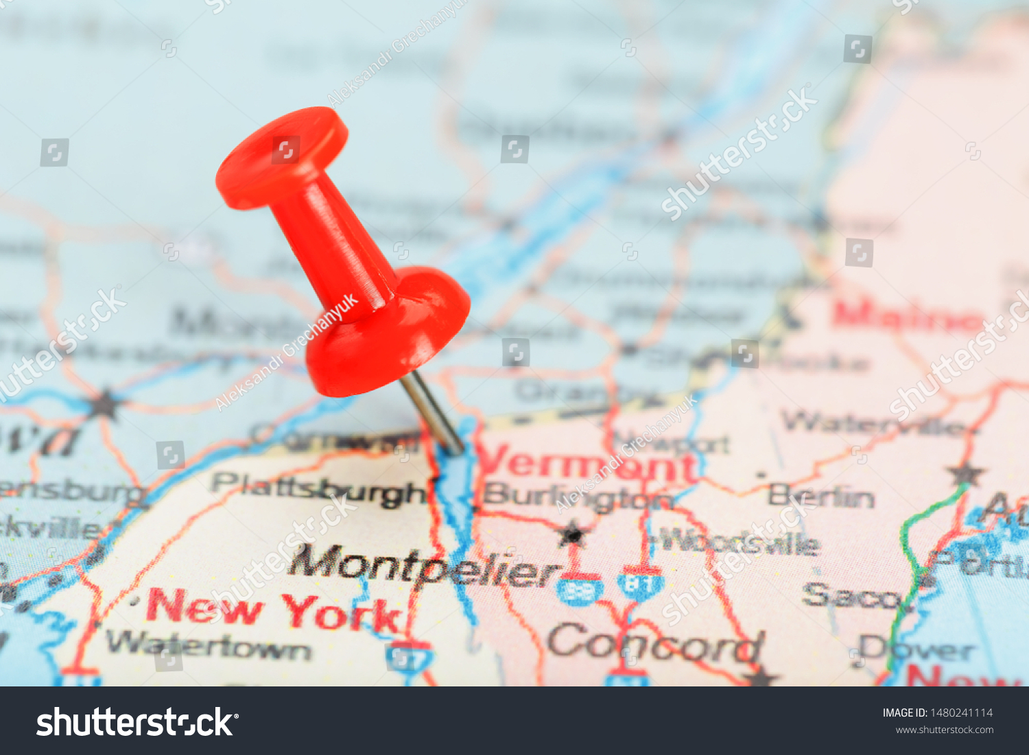 Red clerical needle on a map of USA, South Vermont and the capital Montpelier. Close up map of South Vermont with red tack #1480241114