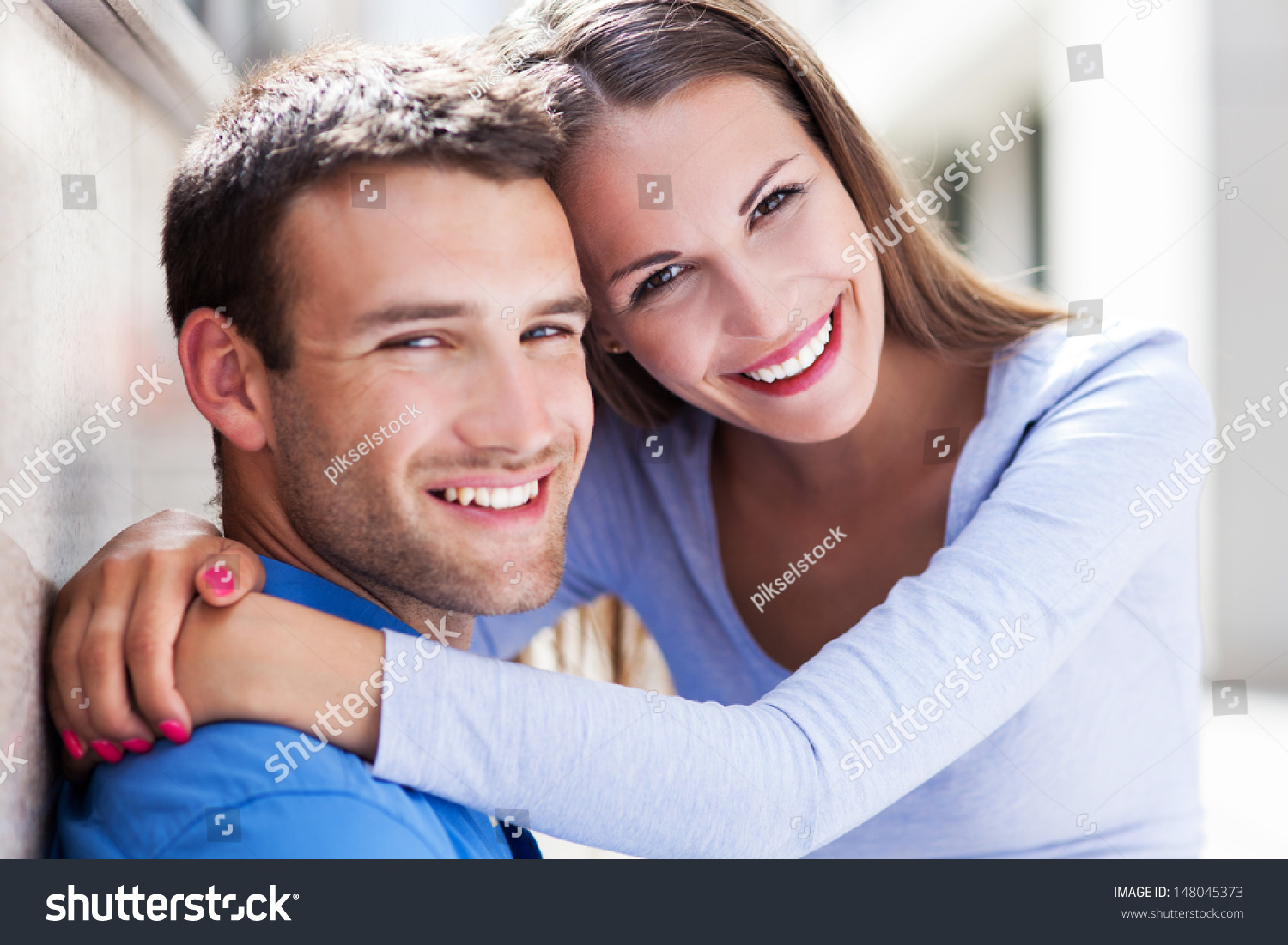 Young couple hugging. Young Couple Hugging Stock Photo 148045373   Shutterstock
