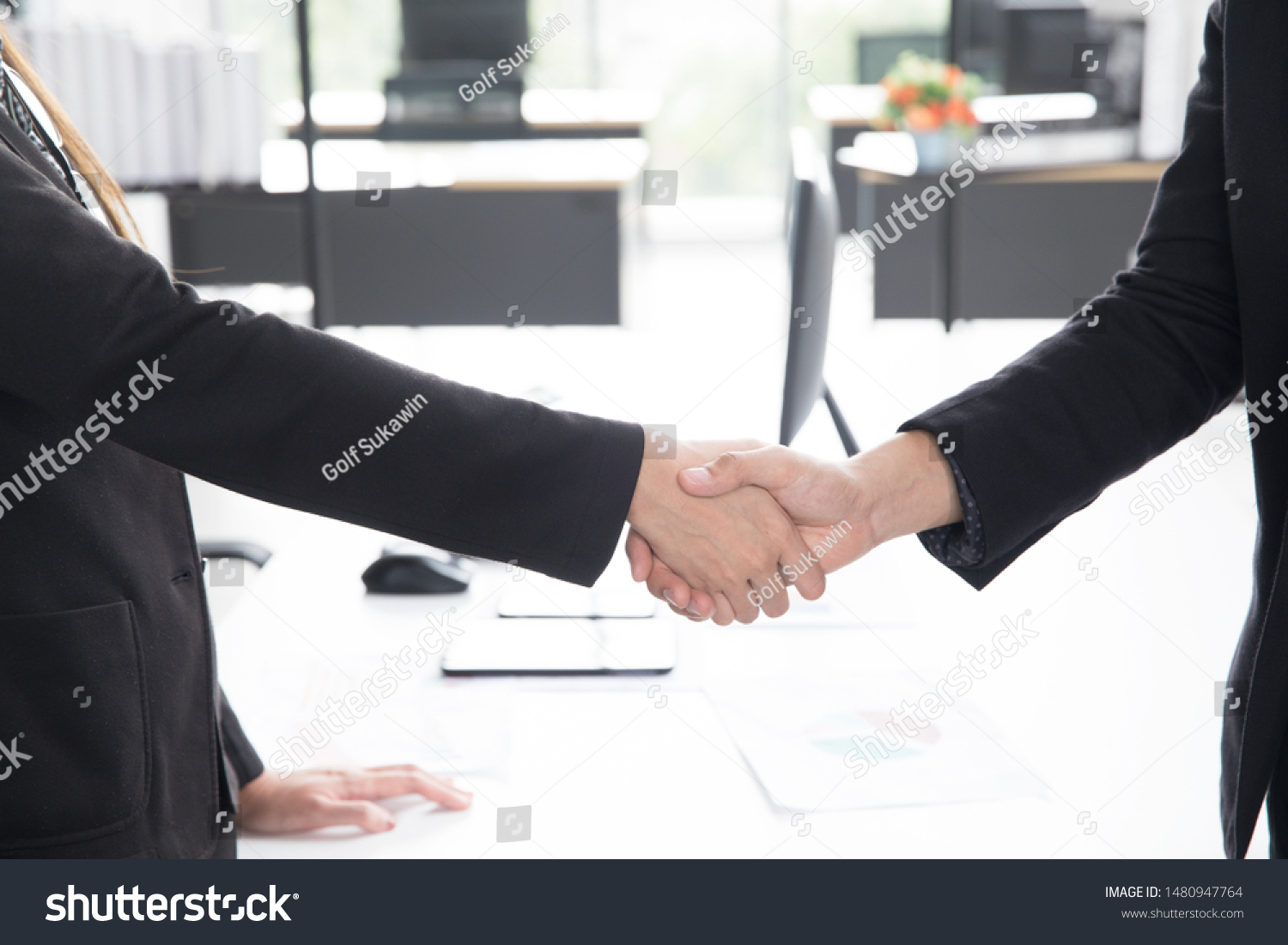 stock-photo-hand-holding-in-business-fir