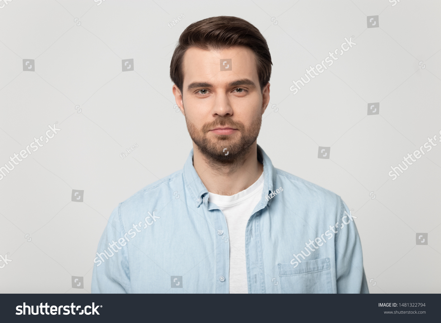 Close up head shot confident serious concentrated young man looking at camera studio portrait, isolated on grey white studio background. Thoughtful millennial guy posing for album photo. #1481322794