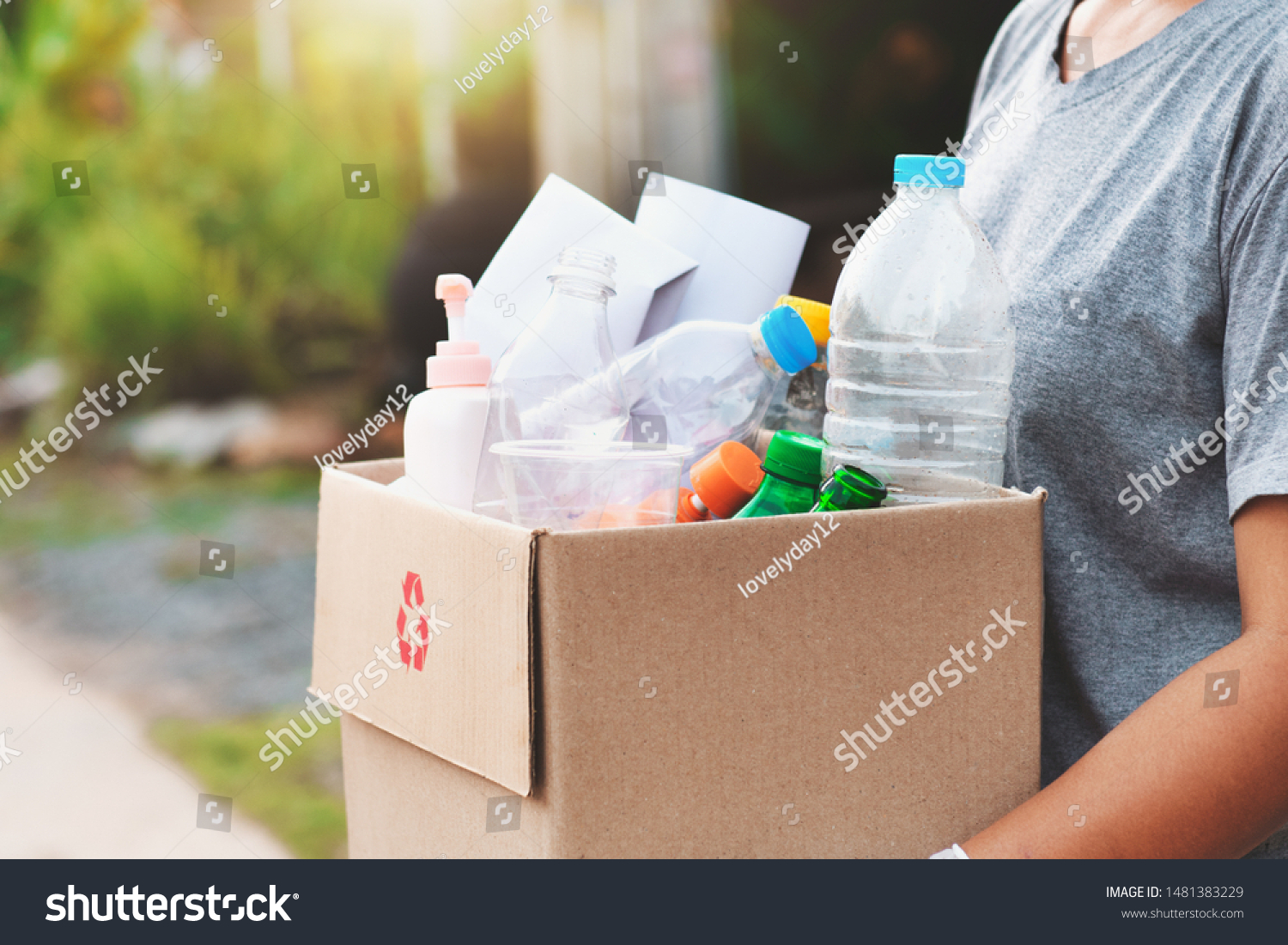 woman hand holdging box garbage for recycle #1481383229