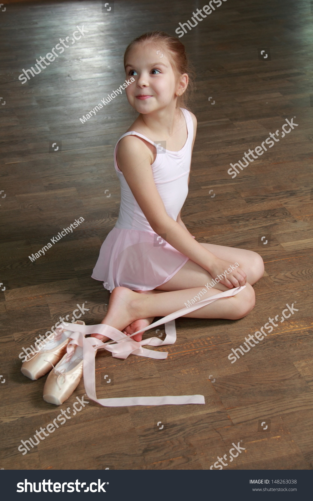 Young Ballerina Puts On Pointe Ballet Stock Photo ...
