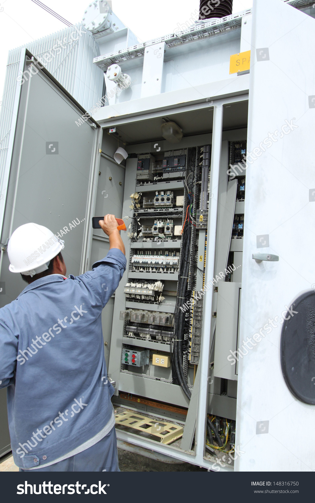 Examination And Measurement Of High Voltage Power Lines In The Wiring A Fuse Board Id 148316750