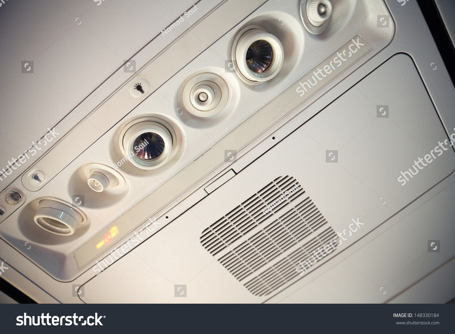 airplane overhead console air conditioning lighting stock photo