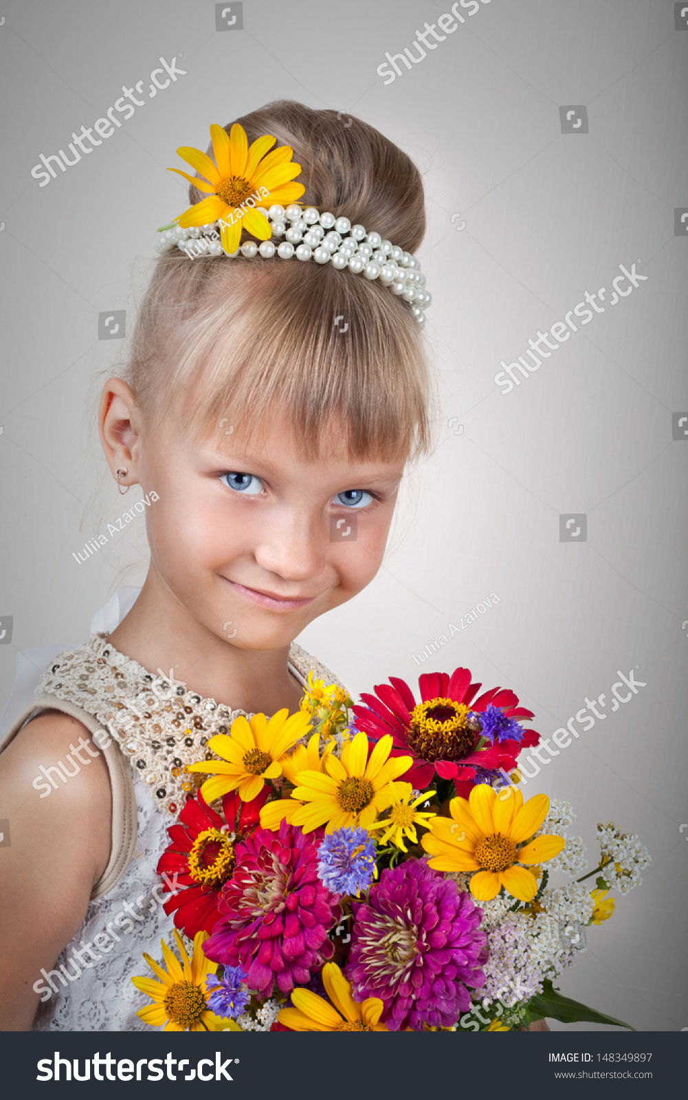 f9f3c6f0bed6 Beautiful little girl in princess dress with long hair with flowers on grey  background #148349897