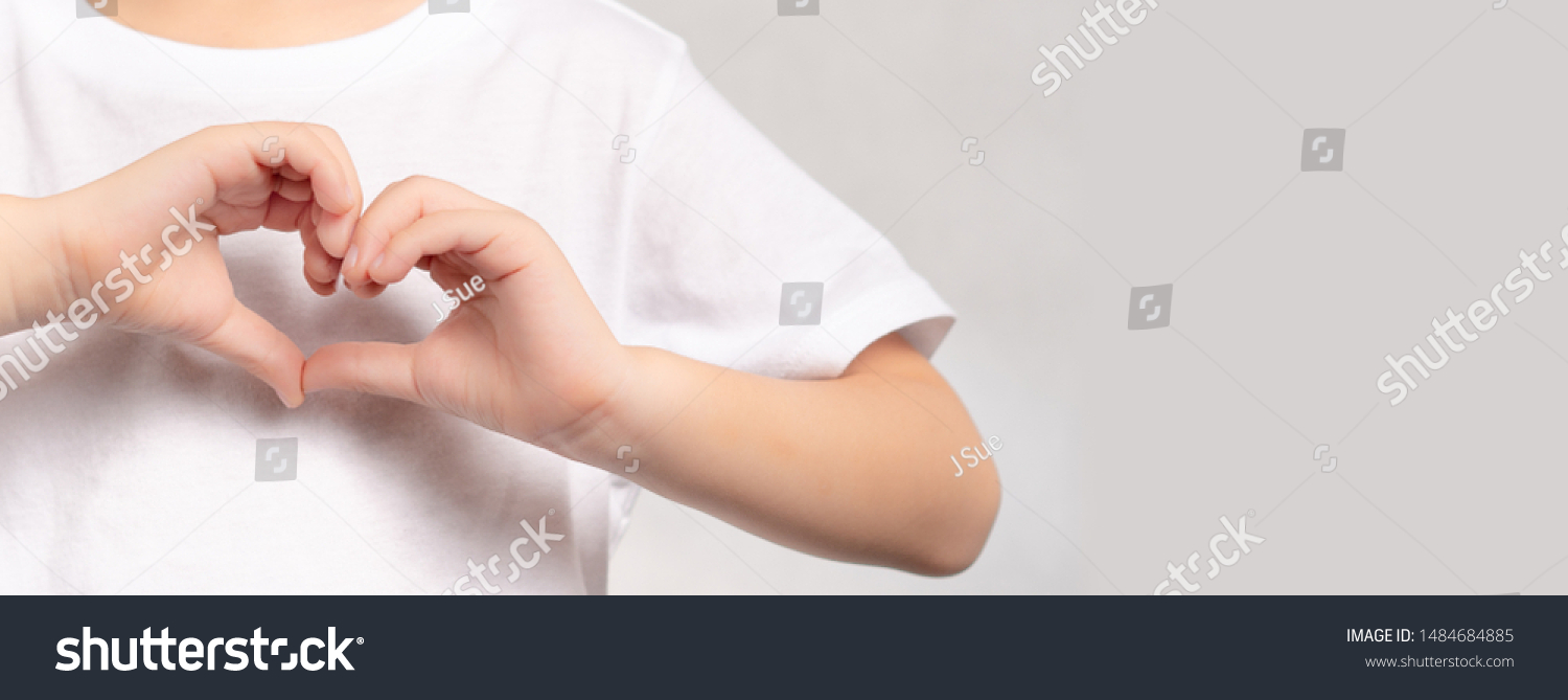 Banner of an adorable little child's hands gesture in heart shape showing love and kindness. Concept of Health care, Charity, Organ Donation, Generous, Pleasure, Hopeful, Love, World heart day. #1484684885