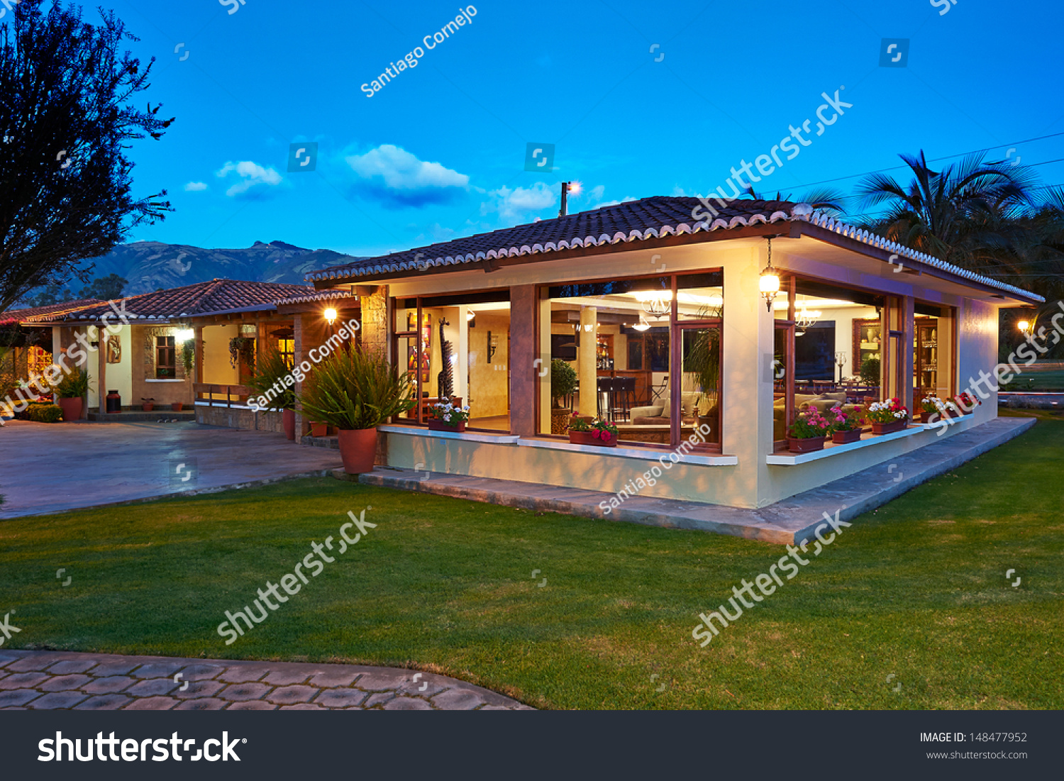 Big modern house night stock photo 148477952 shutterstock for Big contemporary houses