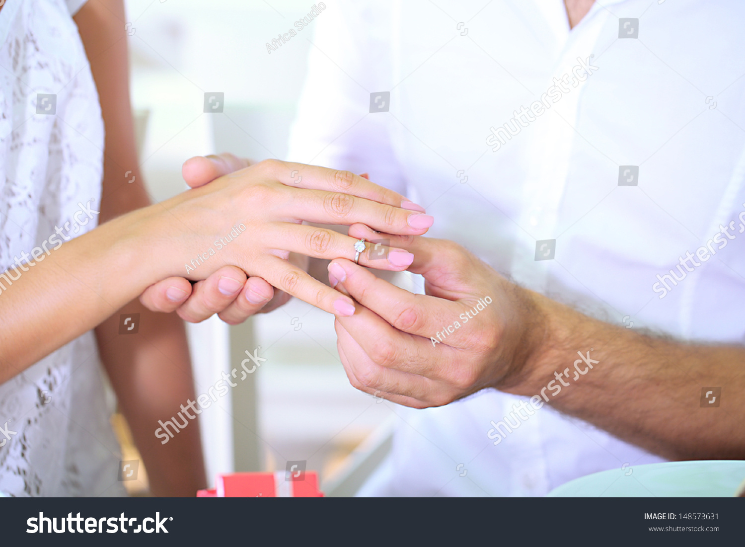Four hands on belly of pregnant woman. Couple posing a hearts with ...