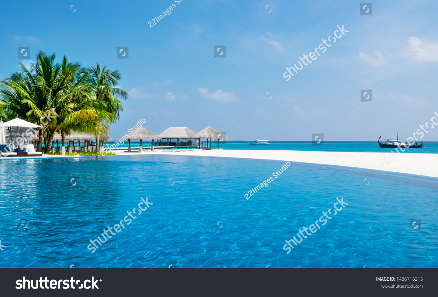 Swimming pool with view on beach and ocean in resort of Maldives. Velassaru island holidays. #1486716215