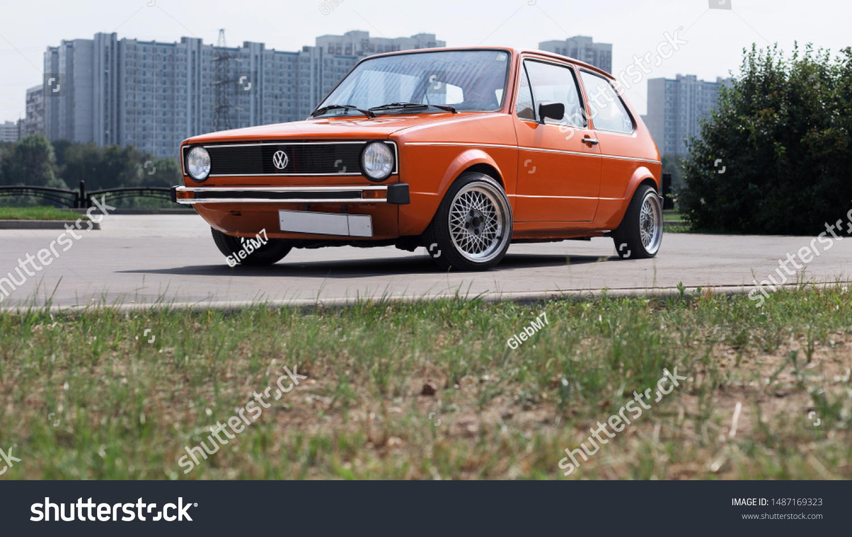 Vw Golf Orange Car City Park Stock Photo Edit Now 1487169323