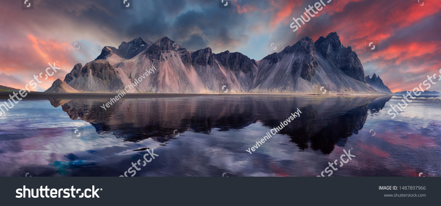 Vestrahorn mountaine on Stokksnes cape in Iceland during sunset with reflections. Amazing Iceland nature seascape. popular tourist attraction. Best famouse travel locations. Scenic Image of Iceland #1487897966