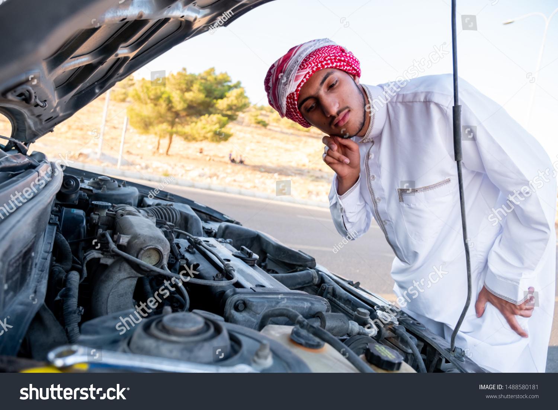 Arabic Man Fixing His Car Stock Photo (Edit Now) 1488580181