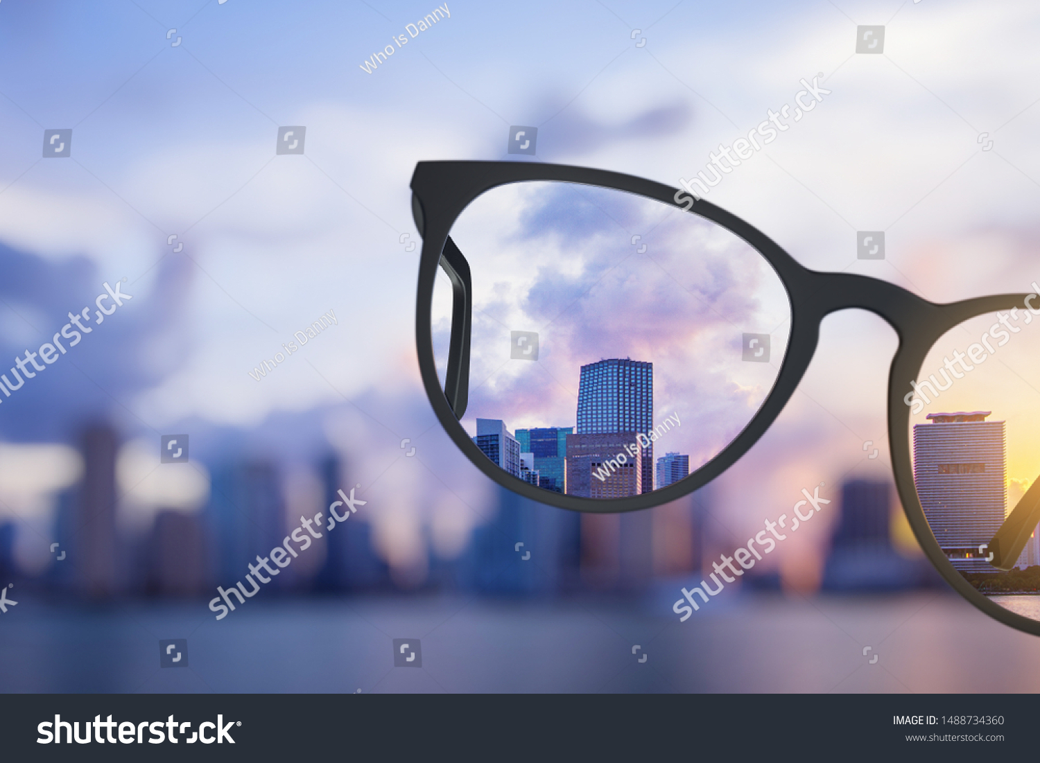 Modern bright city view through eyeglasses. Blurry background. Vision concept #1488734360