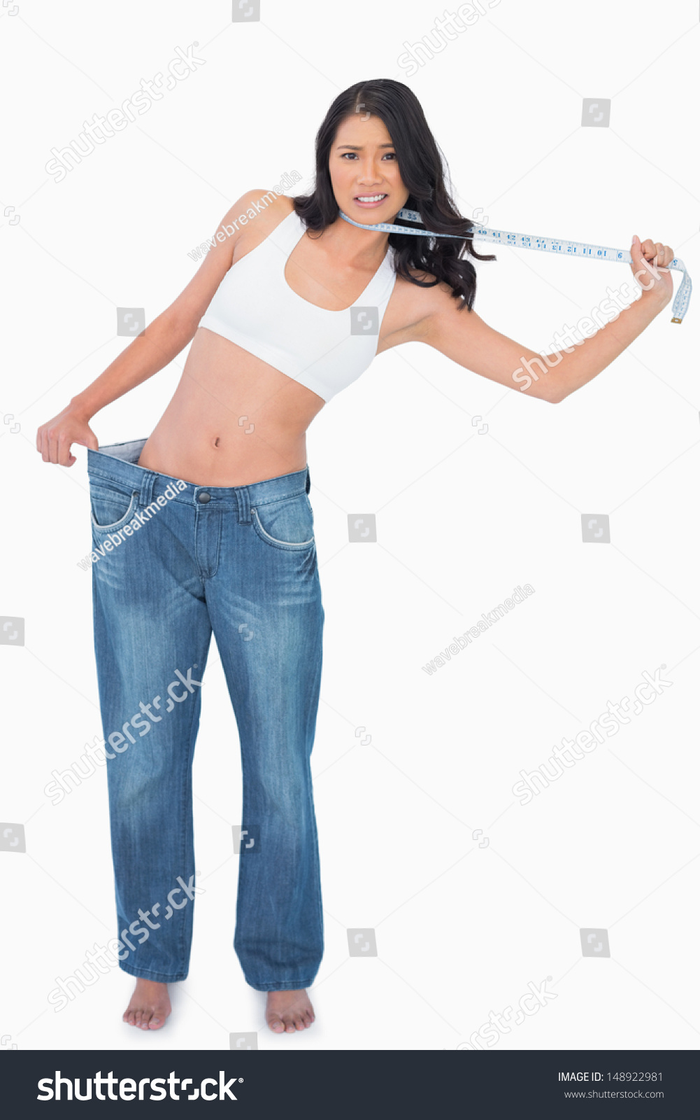 Background image too big - Woman Wearing Too Big Pants And Strangling Herself With Measuring Tape On White Background