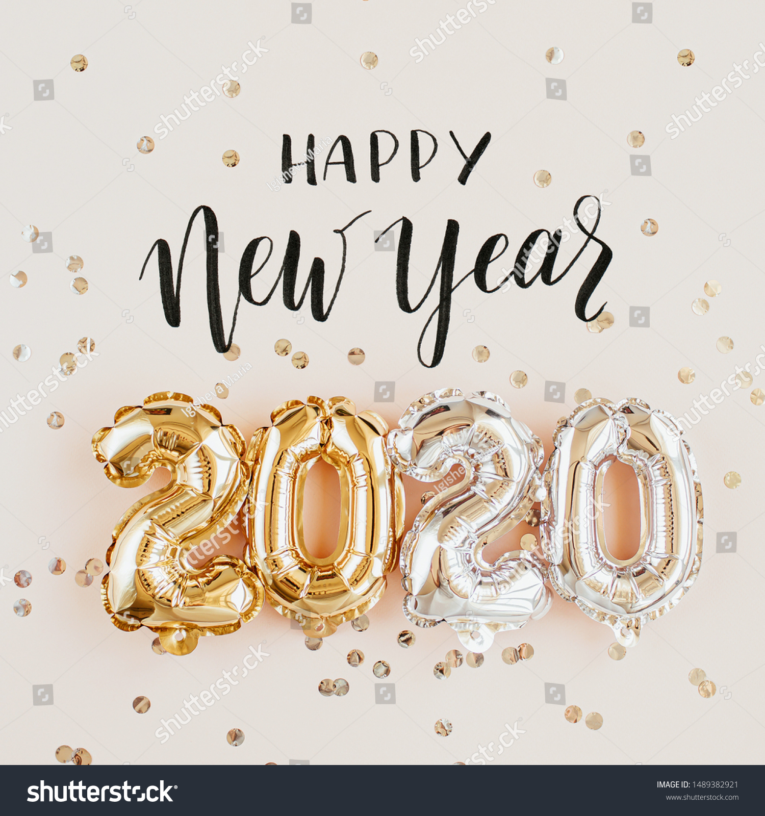 Happy New year 2020 celebration. Gold and silver foil balloons numeral 2020 and confetti on pink background. Flat lay #1489382921