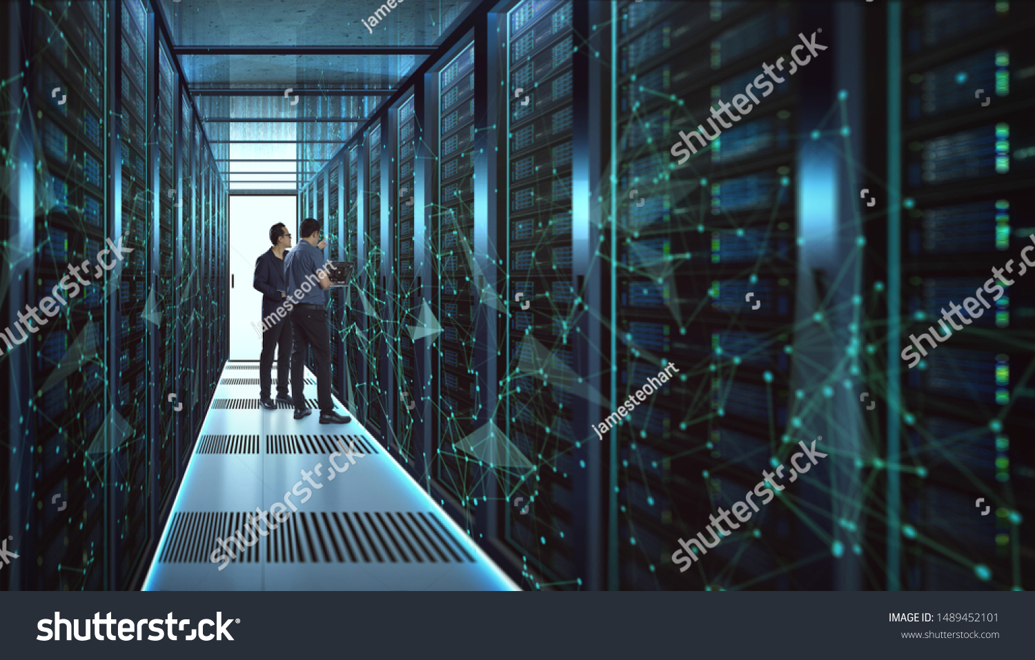 IT Engineers and Technician discussing technical problem in server room with data connection visual effect . #1489452101