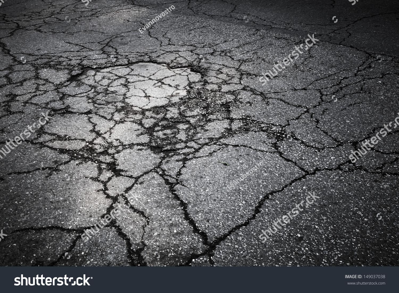 dark asphalt road cracks background texture stock photo