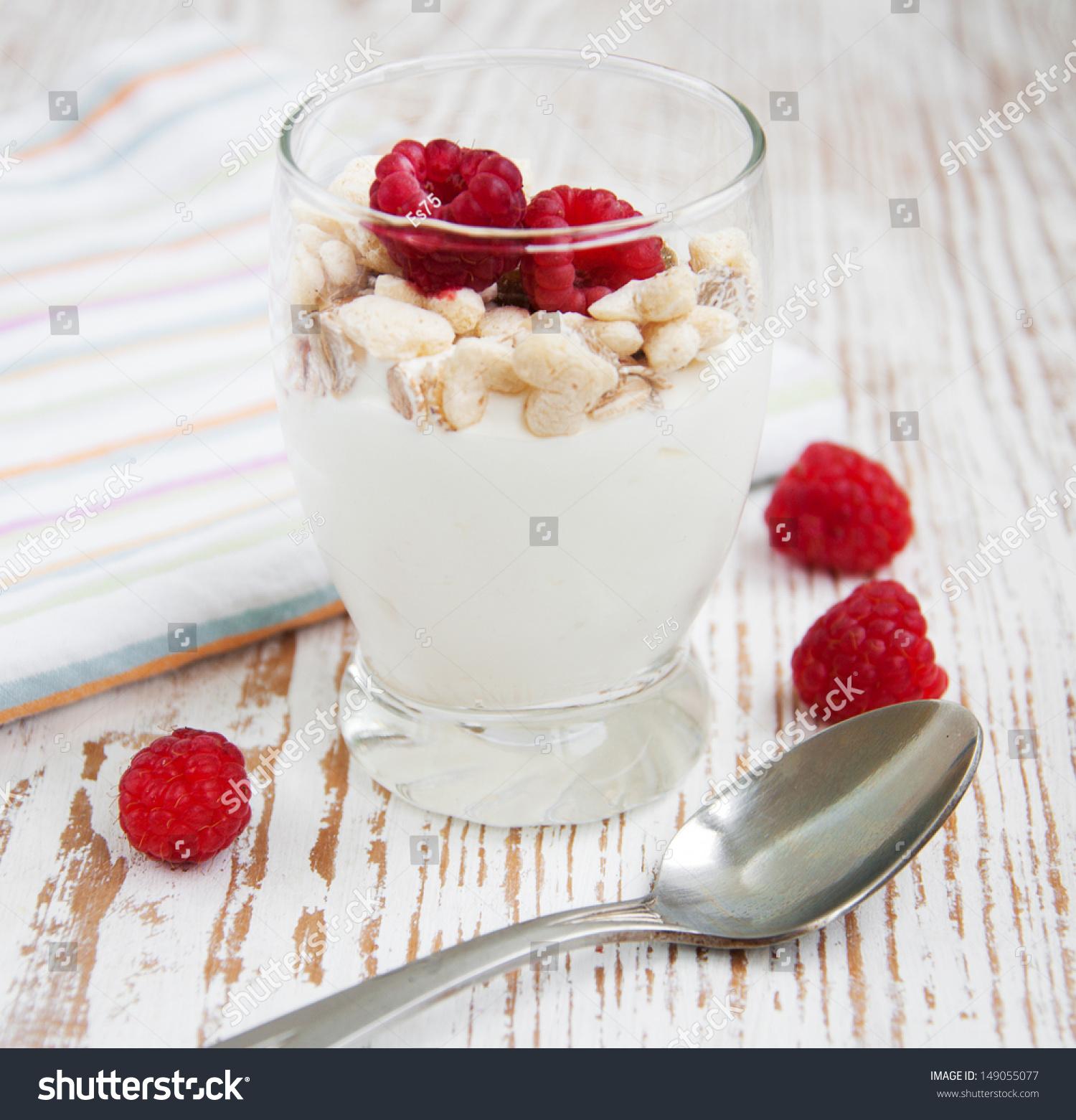 healthy muesli dessert with yogurt and berries stock photo