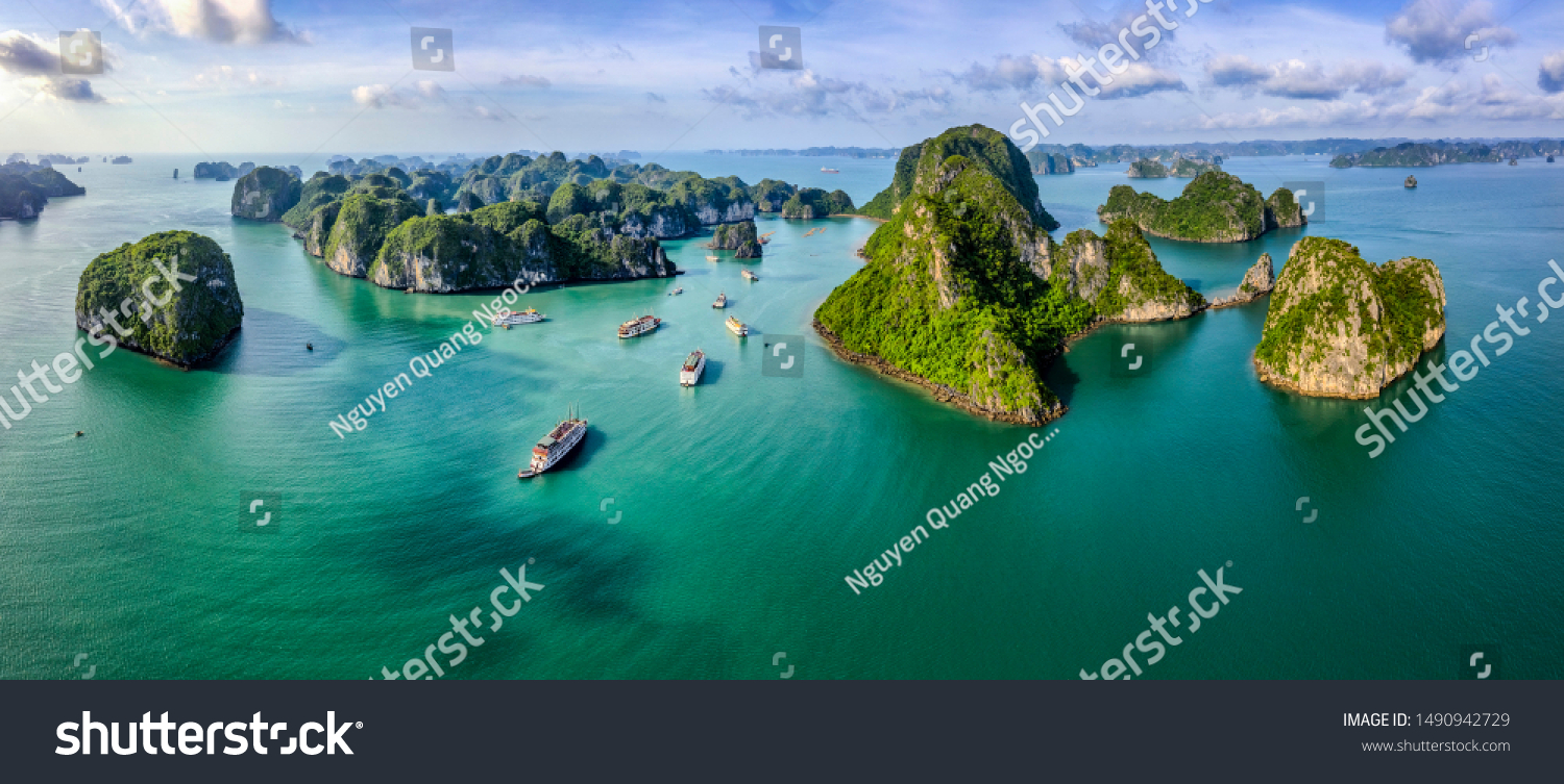 Aerial view Vung Vieng floating fishing village and rock island, Halong Bay, Vietnam, Southeast Asia. UNESCO World Heritage Site. Junk boat cruise to Ha Long Bay. Famous destination of Vietnam #1490942729