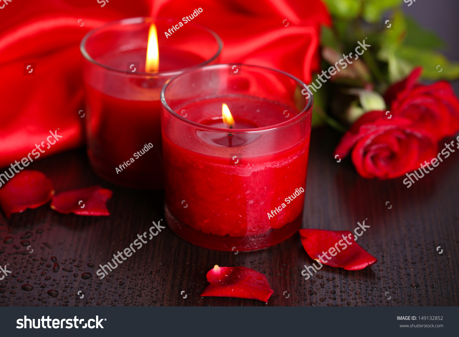 Beautiful romantic red candle with flowers close up ez canvas id 149132852 izmirmasajfo