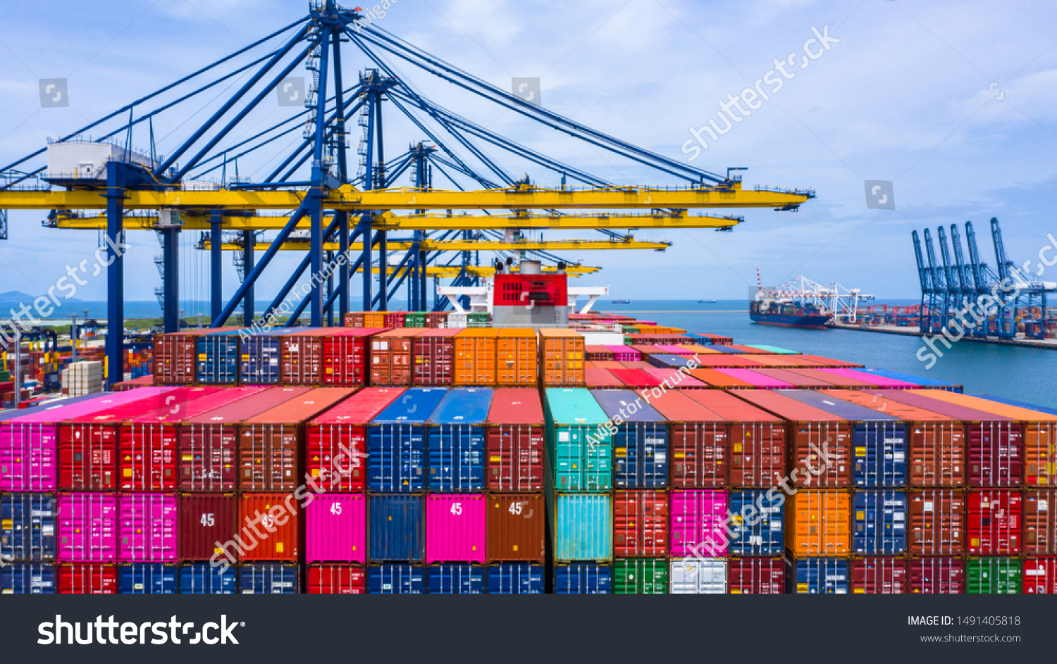 Container ship loading and unloading in sea port, Aerial view of business logistic import and export freight  transportation by container ship in harbor, Container loading Cargo freight ship, Dubai.