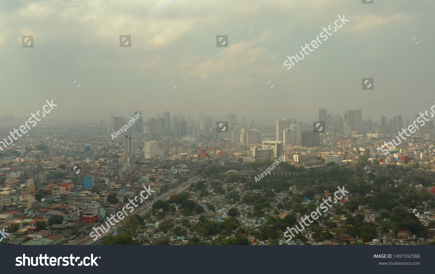 Manila North Cemetery and Cityscape of Makati, the business center of Manila, view from above. Asian metropolis. Travel vacation concept. #1491592988