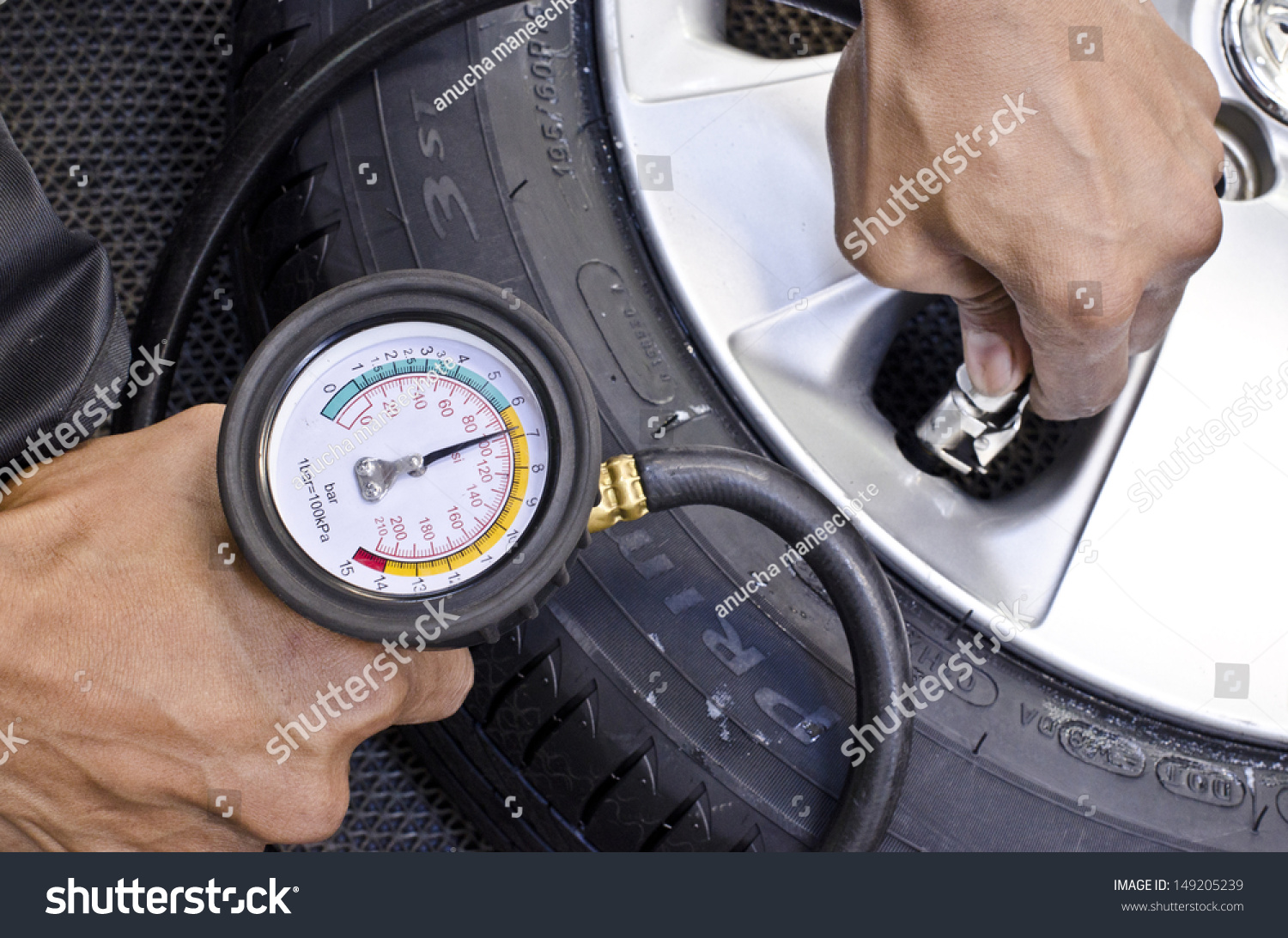 checking tire pressure pumping air into auto wheel vehicle safe concept stock photo 149205239. Black Bedroom Furniture Sets. Home Design Ideas