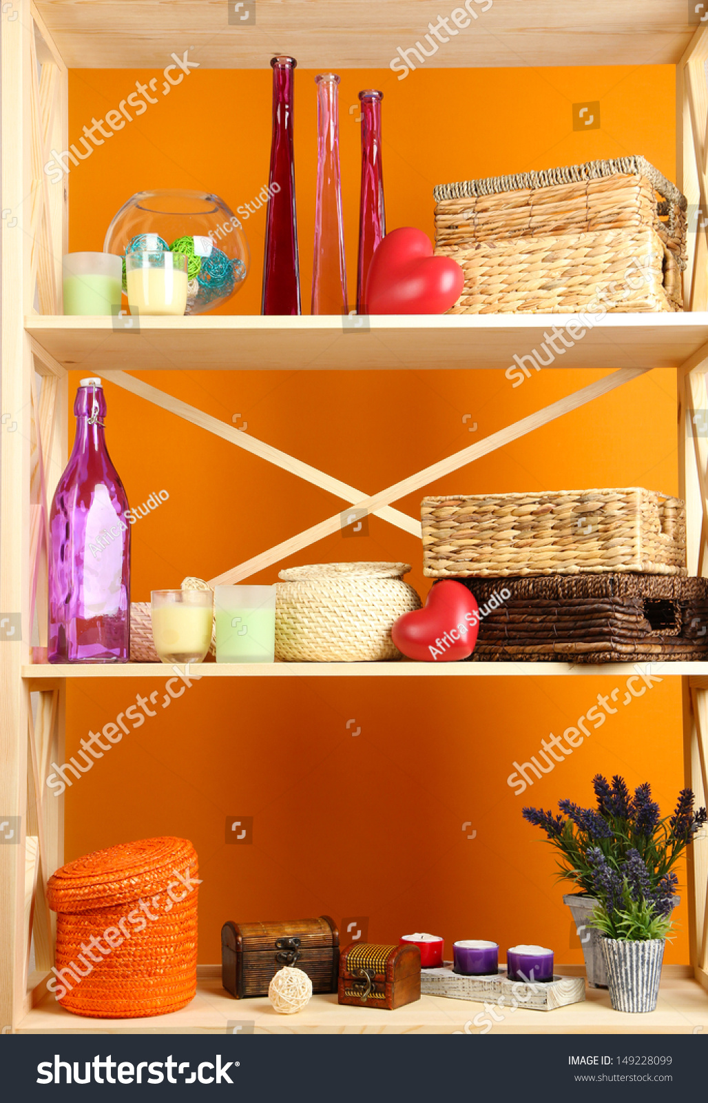 Beautiful white shelves with different home related objects on color wall background stock - Beautiful photoshelves ...