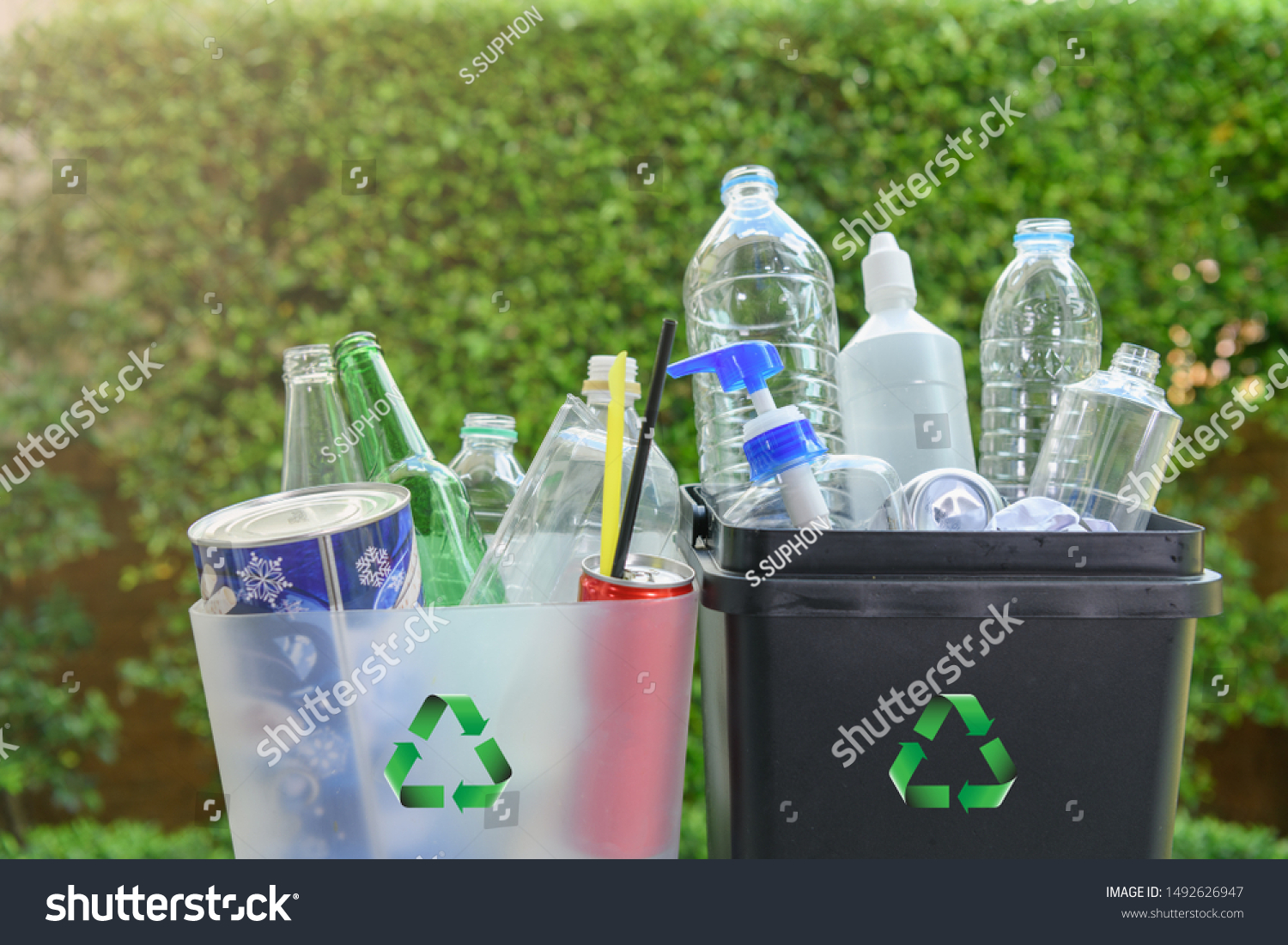 Close up plastic and  glass bottle in the bins for separating recycle materials from the garbages. Reducing waste by following the green concept. Recycling process. #1492626947