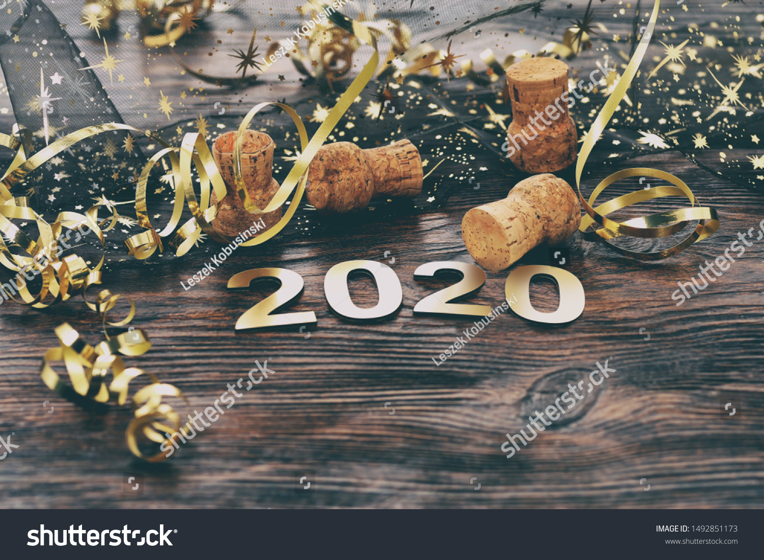 Happy New Year 2020. Symbol from number 2020 on wooden background #1492851173