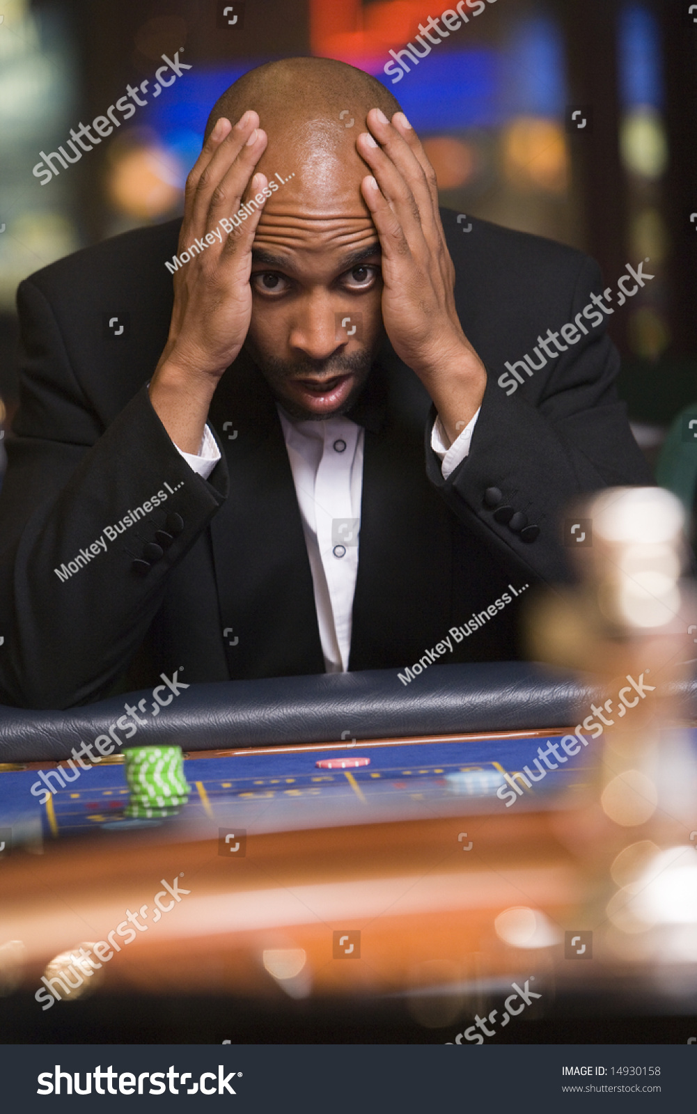 Man Losing At Roulette Table In Casino Stock Photo 14930158 ...