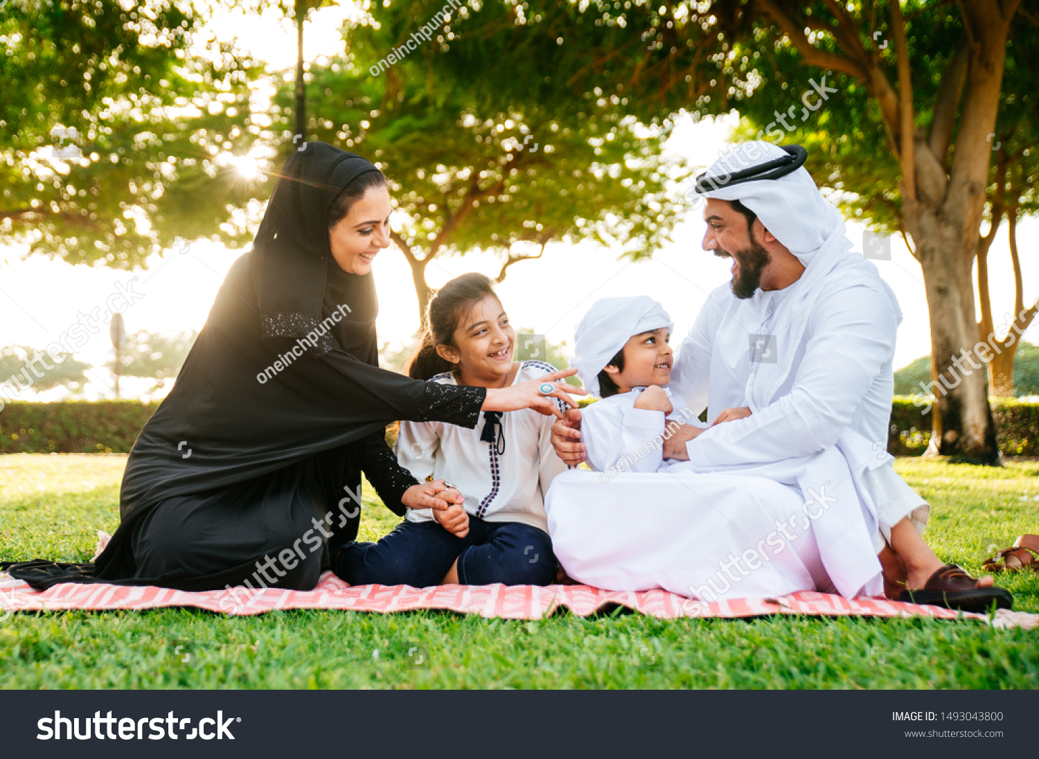 Arabian family spending time in a park #1493043800