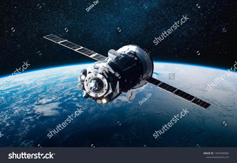 貨物宇宙船と地球惑星 暗い背景 Sf壁紙 Nasaが提供するこの画像のエレメント の写真素材 今すぐ編集